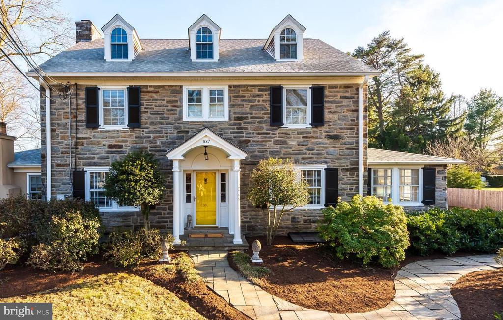Welcome to 537 West Conestoga Road, an exquisitely updated stone Colonial set back on a beautifully manicured lot in the heart of the top ranked Tredyffrin-Easttown School District. This sun drenched home offers four finished living levels and is a perfect blend of Old World Charm and modern upgrades. The gracious center hallway is flanked on the right by an open dining area with chair railing and crown molding. On the left you'll find a spacious family room featuring a gas fireplace with stone surround and colonial mantle. Glass panel French doors open to the fabulous four seasons sunroom offering a second gas fireplace, an exposed stone wall, a pass-through to the living room, built in cabinetry and sliding glass door leading the rear flagstone patio and yard. The gourmet kitchen has been nicely upgraded with gleaming Calacatta marble and polished wood countertops, Calacatta full slab marble backsplash, ample storage and display cabinetry with brass hardware, stainless steel Bosch dishwasher, stainless steel Samsung refrigerator, and a professional grade Bertazonni gas range. A passageway cut from the original stone wall leads from the kitchen to the fantastic mud room featuring a skylight, a doorway to the rear grounds and driveway, sliding barn doors open to a walk-in pantry and a coat closet.  A cozy home office/den off the dining room and a beautifully designed powder room complete the picture for the first floor of this wonderful property. The second floor is home to the sumptuous master suite offering a walk-in closet, two double closets and a renovated master bath with tile flooring, a spacious shower and old style marble sink. Two additional bedrooms are serviced by a hall bathroom with beadboard walls and shower/tub combination. The finished third floor features an open home office/flex space with exposed stone wall, a fourth bedroom, charming dormers and a walk-in storage closet. The finished lower level offers a second family room and is the perfect pla
