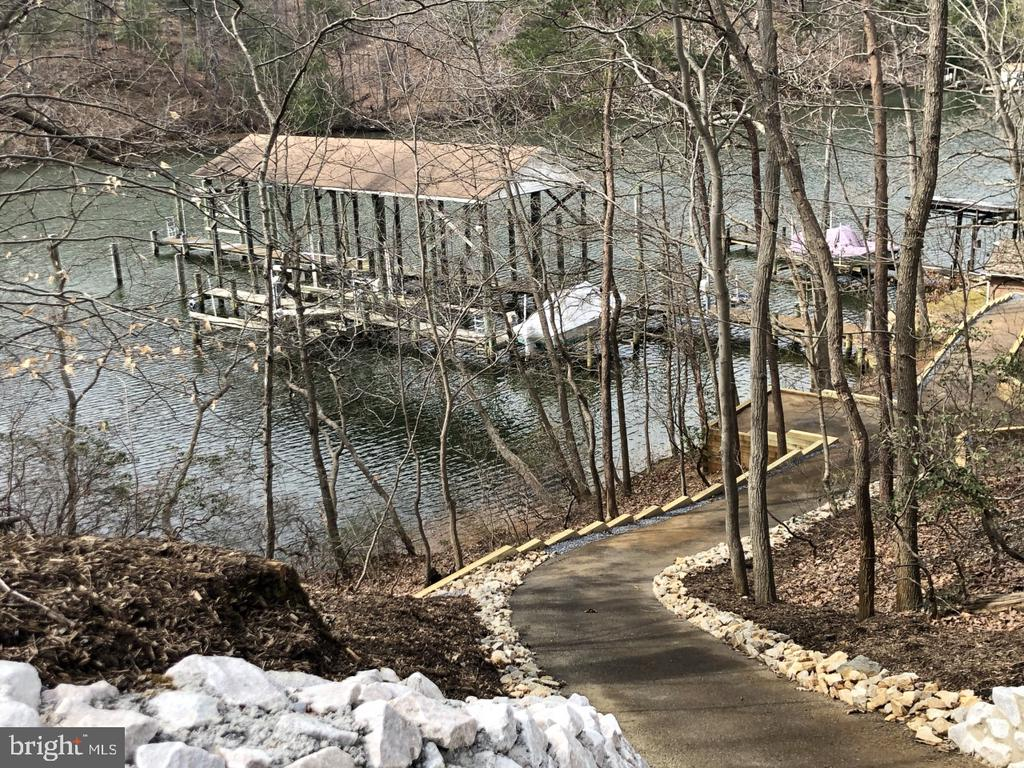 Excellent opportunity to own an in town home on almost 3 acres on beautiful Luce Creek off the Severn River. 1500 ft. of shore line with deep water. 60 foot long boat house, 125 foot long pier that will dock a 130 foot yacht. 3 boat lifts and 2 jet ski lifts.  2 BR, 2 Bath home has been updated with recent gourmet kitchen and is move in ready. New septic system and Well. Very private with endless possibilities!