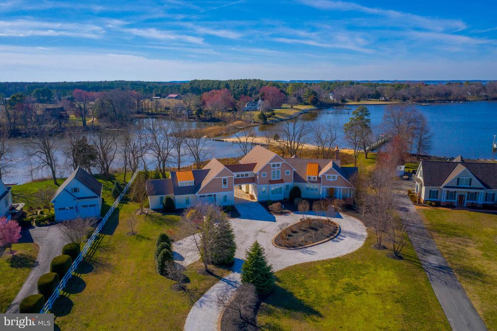 Breathtaking Waterfront Property located in a Secluded Cove with a Private Sandy Beach and Pier at the mouth of the Corsica River!  No expense was spared in this Truly Unique and Amazing 4700+ square foot property with 5 Bedrooms, 4 Full Bathrooms, 2 Half Bathroom & loaded with Natural Light.  Some of the many upgrades include White Oak Hardwood Floors, Open Gourmet Kitchen with Wolf Range and Marble Counter-tops,  Cathedral Ceilings, Main Level Master Suite with His and Hers En Suites, Expansive Water Views from Most Rooms, Geothermal HVAC System, Finished Basement and the list continues.  Easy access to waterway from rear garage to the  Private Beach and 100'  Pier with Boat Lift and 4 Jet Ski Lifts!  The Perfect Family Retreat awaits in this Stunning Waterfront Property - You will Never want to leave!  No Flood Insurance required.  Call today to schedule a Private Tour!