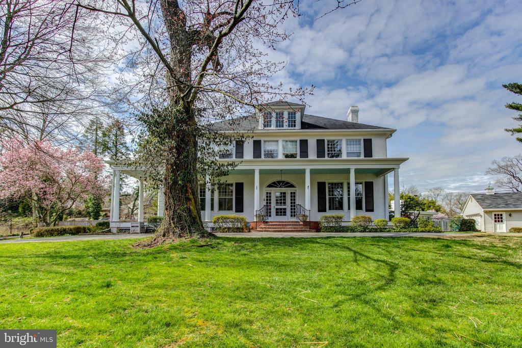 Built in 1882, this home is one of the three original farmhouses of Chevy Chase. This antebellum style manor home features a gated entry, a beautifully landscaped estate, and a gorgeous wraparound porch. As you enter the home, you take an exciting step backwards in time, and will immediately notice some of the key features of this home. This includes the expansive and bright living room, the formal dining room, and gourmet kitchen with double wall ovens. In addition, the main level of this home offers a stylish bonus room perfect for a home office or den. As you move to the 2nd level, you will find 5 spacious and unique bedrooms, and 4 full bathrooms. The top level of this incredible home offers an intriguing and exciting rec room with dazzling views of the estate. This home offers a once in a lifetime opportunity to own a piece of history, and is ready to share that history with you.