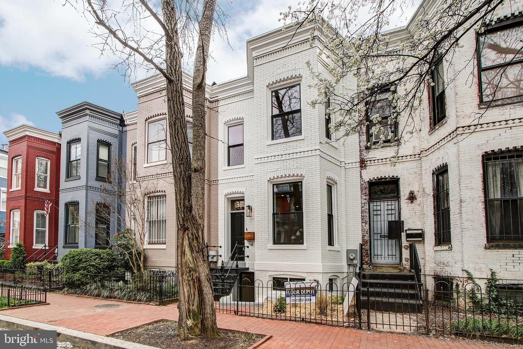 Contact Brent Jackson for showings at 202-263-9200 or robandbrent@ttrsir.com. Another stunning redevelopment by Dilan Homes combines modern and classic design in the heart of Logan Circle. Boasting 4 beds/3.5 baths, the large open floor plan is an entertainer's dream, with herringbone white oak floors directing you from the living area with bay window, to the spacious dining area, and gourmet kitchen beyond. Prepare Instagram worthy meals with the stainless steel Viking appliance suite and massive island with waterfall Calacatta marble countertops. French doors reveal a private outdoor space with bijou deck, automatic garage door, and parking. Upstairs, three well apportioned bedrooms and two full baths in rich marble tile, including the master, featuring two large closets, high ceilings, and en-suite bath. The lower level includes a separate guest suite, with living area, kitchenette, full bedroom and bath, and dedicated laundry, as well as interior and exterior access. Less than a block from 14th Street with its endless options for dining, shopping, and fun!