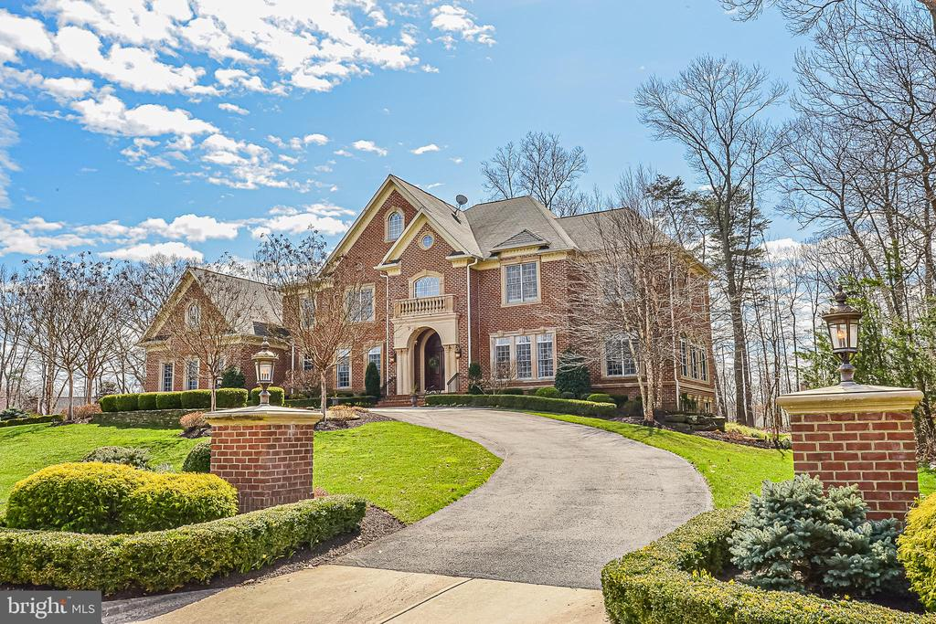 Searching for a Warm & Welcoming Home with a Masterful Design, Quality Features and Exquisite Details throughout?  Look no further! This impressive, meticulously maintained 5+bedroom, 7full/2half baths, all brick home has over 12,000 sq. ft. of gracious living.  Situated on 1.74 acres at the end of a private cul-de-sac, the circular drive creates a nice sense of arrival.  Elegant marble floors greet you in the grand foyer, where you will immediately begin to appreciate all the gorgeous architectural details, including a dramatic stairway with ornate oak & wrought iron railings, magnificent coffered/vaulted/tray ceilings, archways, columns, decorative moldings and stunning light fixtures. Plenty of natural light flows throughout the home's open, airy layout. A formal Living Room to the right is bright and quite spacious.  A stunning Dining Room to the left, complete with a well-appointed Butler's Pantry with 2nd full sized Subzero, is a great place to entertain.  Straight ahead, the generously sized Family Room draws you right in and is graced by a gorgeous two-story stone gas fireplace, palladium windows, plantation shutters and custom built-in Entertainment Center.  The handsome Study features built-ins and windows galore. Beyond the study, a lovely Sunroom is tucked away for a nice sunny place to escape, relax and take in the views of nature.  The gourmet, top-of-the-line Kitchen will inspire your inner chef with its three ovens, six+burner gas cooking, pot filler, warming drawer, microwave drawer, built-in Miele espresso machine, two dishwashers, and Subzero refrigerator/freezer.  The kitchen has all the granite counter space you could ever want, including a 12' island with seating for four.  In addition to the kitchen island, there is a separate Breakfast Bar with more seating and equipped with Subzero beverage refrigerator, sink and 3rd dishwasher.  Premium finishes, fixtures and elegant lighting are the standard.  There is a huge well lit walk-in Pantry with s