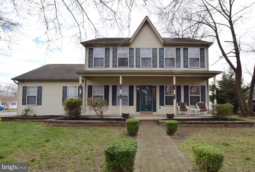 A rare find! Two master bedrooms.  One master is on the first floor.   This is a great opportunity.  Walk downtown to the adorable water front of Delaware City. Enjoy, boutiques , shops, restaurants, and the water front park . Let's not forget the opportunity to eat crabs at the down town restaurants.   Wonderfully maintained home.  Large family room opens to the eat in kitchen.  Loads of cabinet space.  All bedrooms are very generous in size, with three of them featuring walk in closets.  The master features a four piece bathroom, to include a soaking tub, separate shower and a double vanity.   One of my favorite features of this home, is the awesome front porch.  Enjoy your favorite drink as you relax and enjoy the comfort of this porch.   All this home is waiting for is it's new owner.