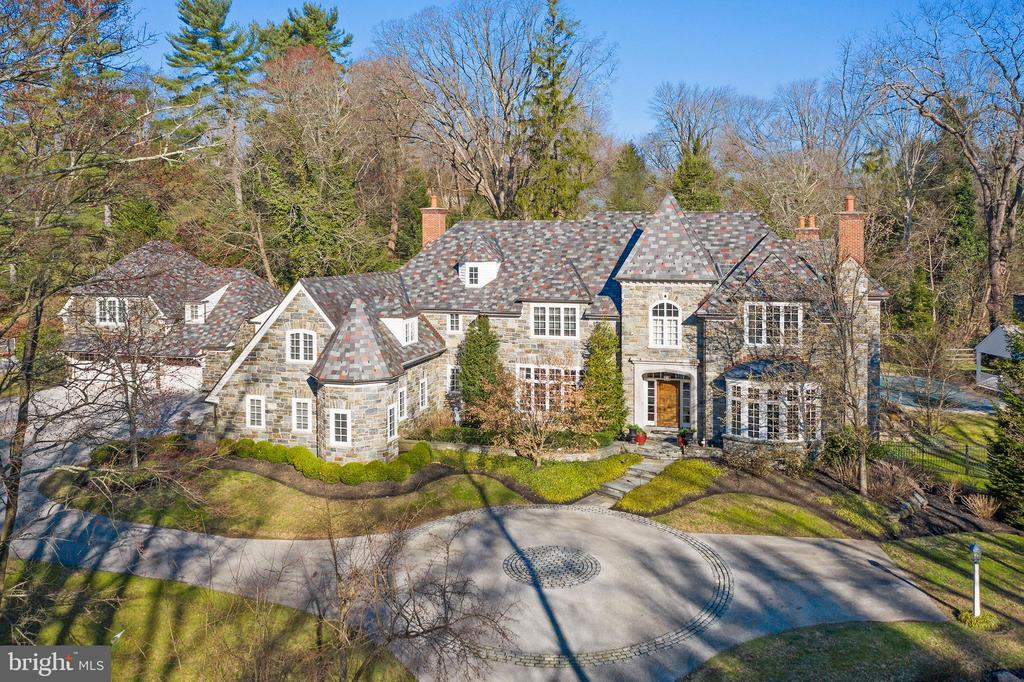 """Incredible opportunity to move right into this exquisitely crafted masterpiece, recently constructed by renowned Pohlig Builders and set on a breathtaking 2.3 acre lot with pool, Carriage House and Pool House in one of Villanova's most prestigious and highly coveted locations. Extreme attention to architectural detail while carefully blending old world materials with every modern amenity and refinement is evident throughout this all stone residence, with stunning slate roof and matching secondary structures. Features include 10"""" ceilings throughout the first floor and 9"""" ceilings throughout the second floor, massive sun-filled windows with a wonderful open floor plan, beautiful moldings, casements and millwork, wide- plank hand carved oak floors, gracious room sizes throughout, a fabulous custom Gourmet Kitchen with top of the line professional appliances,  First Floor private In-Law Suite with full Kitchen and Bathroom, Luxurious Master Suite with His and Hers marble Baths, 4 additional spacious second floor Bedrooms with custom En-Suite Baths, an expansive beautifully finished Lower Level and incredible separate Carriage House Guest Apartment with vintage Kitchen and Full Bathroom, Living Room with fireplace and cozy Bedroom.  This rare treasure offers serene privacy while being close to renowned schools, shopping, restaurants, trains, all major commuting routes and just minutes from Philadelphia International Airport and Center City Philadelphia.  LOW TAXES."""