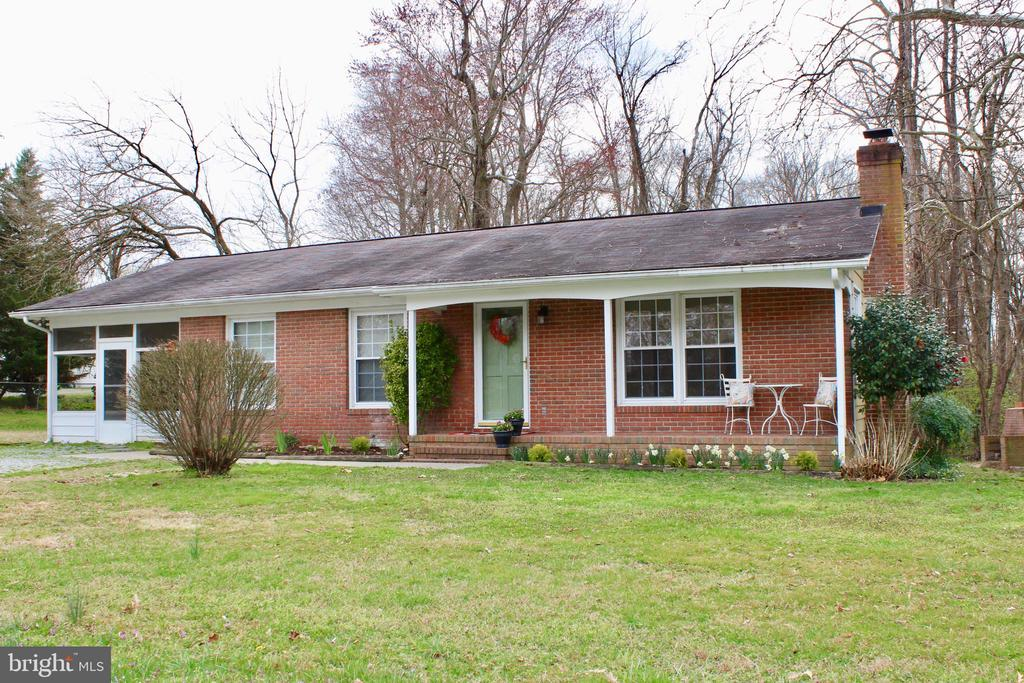 Enjoy the conveniences of town without town taxes. Charming 3 bedroom, 1 1/2 bath rancher with a cozy fireplace. Would make an excellent starter home or rental.
