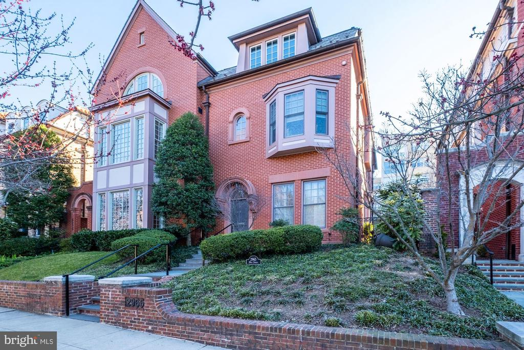 NEW LISTING - VIRTUAL SHOWINGS AVAILABLE UPON REQUEST! Welcome to this beautiful, and rarely available, home on sought-after Alban Row. Alban Row is a group of 15 homes along the East side of 38th Street NW between Garfield Street and Cathedral Avenue. This tight-knit community is the perfect place to call home, right around the corner from the National Cathedral. Just a few short blocks to the Cathedral Commons shopping area, with markets, restaurants and shops, and a few blocks from Trader Joe's and the Social Safeway. Enjoy quick access to National Airport from Massachusetts Avenue and Rock Creek Parkway. With 3,400 square feet over four levels, this spacious, custom semi-detached home checks all the boxes. The elevator services all four meticulously finished levels, from the private 2-car underground garage to the tree-top upper level. As you walk through the front door into the foyer, you immediately notice the welcoming living room and formal dining room. The chef's kitchen boasts granite countertops, double ovens, a 6-burner Viking stove, subzero refrigerator, and a spacious center island that adjoins the family room, making this home perfect for entertaining. The main level also has a powder room and two gas fireplaces. The second and third levels consist of four bedrooms and three full baths, with every detail considered. The second level features a spacious owner's bedroom with two walk-in closets, a 9-foot tray ceiling, and a gorgeous granite double vanity in the en suite bathroom. The second bedroom looks over 38th Street with beautiful oversized windows and features a large closet and en suite bathroom. The third level features two more bedrooms, a full bathroom, a large lofted sitting area and a spacious laundry room with plenty of cabinets and a sink.