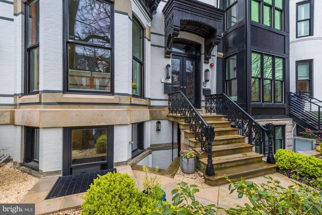 NEW PRICE! STUNNINGLY BEAUTIFUL 2,387 square foot condo in the heart of Logan Circle on a quiet, tree-lined street, walkable to an array of D.C.'s best restaurants, boutiques, fitness studios & grocery stores. Gut renovation of building in 2018 created a gorgeous all-new property that is truly a delight.  Owner upgrades include top-of-the-line SmartHome components, multiple televisions, built-ins, master bath restructure and more.  Spacious and light-filled, the 3 Bedroom, 3.5 Bath Duplex offers outdoor spaces (deck, patio, private terrace) and SECURE PARKING. Open floor plan with luxury features inc. 10 & 11 foot ceilings, lovely white oak herringbone flooring (hand-cut on-site), gorgeous millwork, heated bathroom floors, pocket doors. The expansive main level offers large Living and Dining Areas with fine fixtures and built-ins, and opens to a deck with steps to a large enclosed private terrace for outdoor entertaining. The striking Kitchen with waterfall island offers Subzero/Wolf appliances including a wine frig.  The Owner's Bedroom Suite offers a generous space with a sitting area and doors opening to a small patio, large customized WIC and luxury Bath with marble shower, tub and heated floor. Another large Bedroom at the front of the house enjoys a bay window and private Bath. The third Bedroom is currently in use as an office. The bedroom-level of the house offers a spacious Gallery area and Hall Bath, as well as separate Laundry Room and storage area. Taken to the next level by the current owners, improvements include titanium gun metal Koehler fixtures, custom light fixtures, smart home entertainment/internet/security system, window treatments & closet systems. Most furnishings negotiable. Don't miss this special offering!
