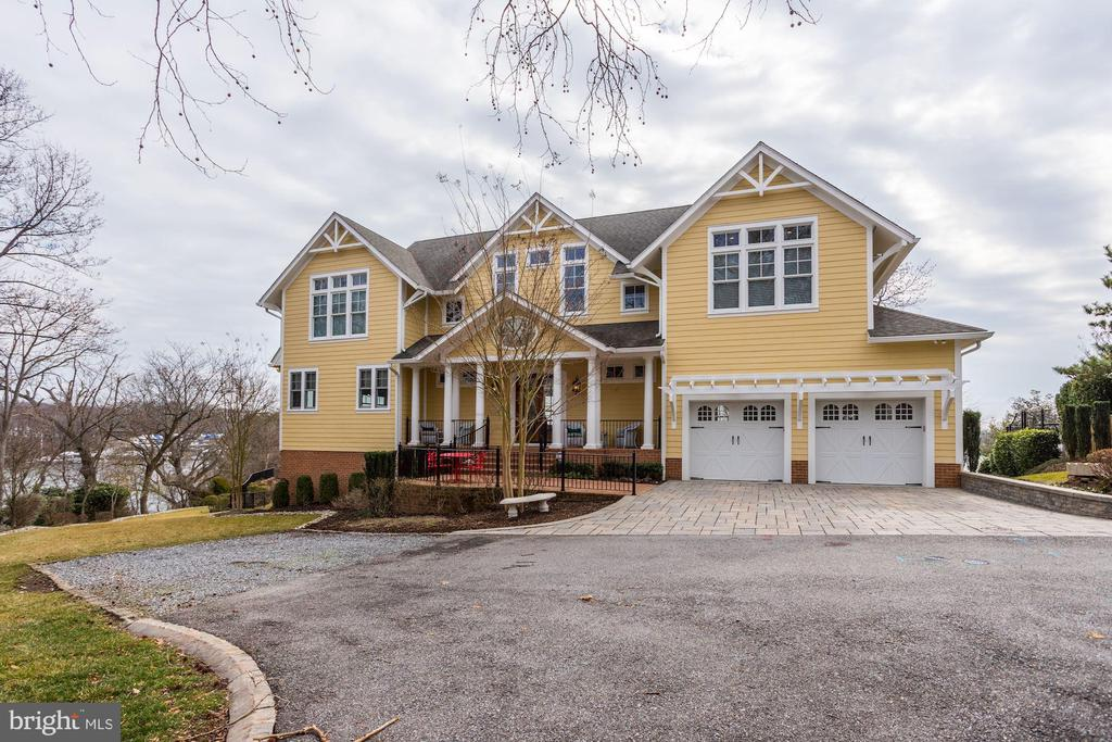 A VIRTUAL SHOWING MAY BE SCHEDULED THROUGH THE LISTING AGENT...Luxurious custom built waterfront home.  Elegantly positioned on just over a half-acre with incredible views overlooking the South River.  Open the front door and reveal stunning views to the waterfront.  The spacious living room on one side and dining on the other, each with spectacular views.  Not to be missed is the gourmet eat-in kitchen featuring Silestone counters, 2 sinks, GE Monogram appliances,  beautiful tile backsplash, and walk-in pantry.   The master suite features picture-perfect views a spacious entry and wet bar, as well as two custom-built walk-in closets.  The impeccable master bath enjoys a walk-in shower, stand-alone bathtub, and a separate water closet.   Each of the other second floor bedrooms are en suite, as well as a second-floor laundry room.  Other features include two fireplaces, a sizable finished basement with a guestroom and two full bathrooms, a beautifully landscaped yard overlooking the South River with a custom-built fire pit.  A private pier and electric boat lift.   The home is run on Geothermal energy and also has a full home generator back up.   An ideal primary or secondary residence and a once-in-a-lifetime opportunity to own a significant part of the South River waterfront.  Welcome to 203 Cape St John.