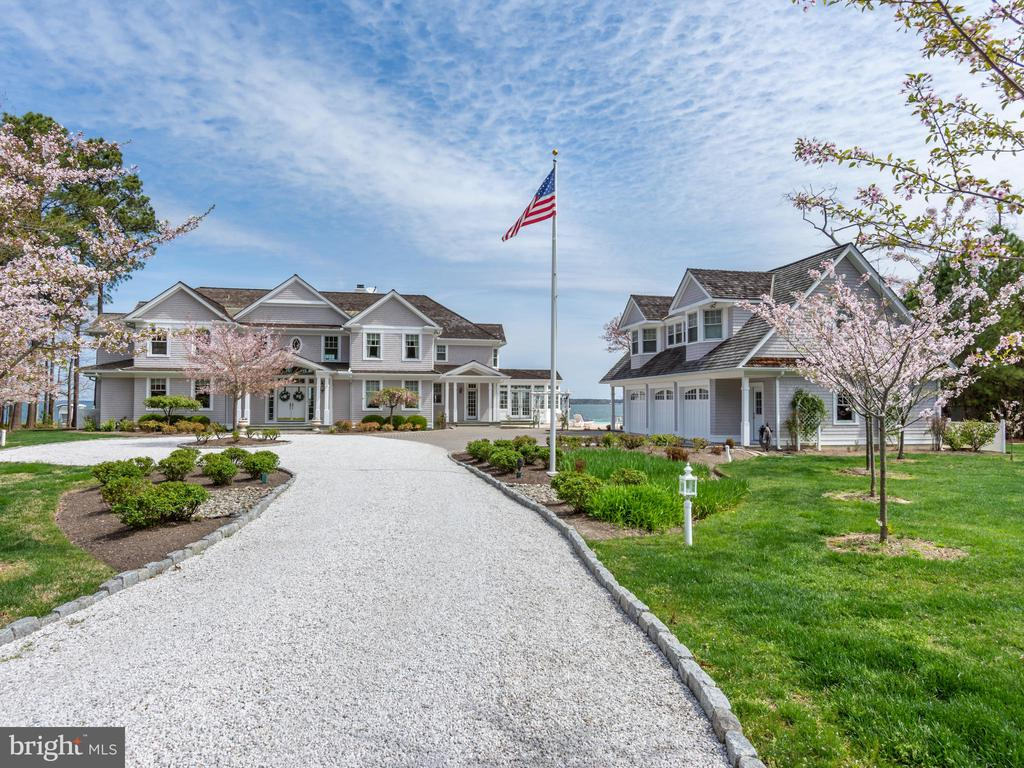 Located within two miles of historic St Michaels, this two-acre +/- waterfront estate brings together the needs of the most discerning of buyers.   The house enjoys an unusually generous elevation that give way to breathtaking vistas over the Miles River, to Eastern Bay and beyond.  The well-manicured, lush grounds are only topped by the custom millwork and the thoughtful space planning that allow visitors to enjoy the outdoors even when relaxing inside.  Separate guest quarters above the garage make this a fantastic retreat.