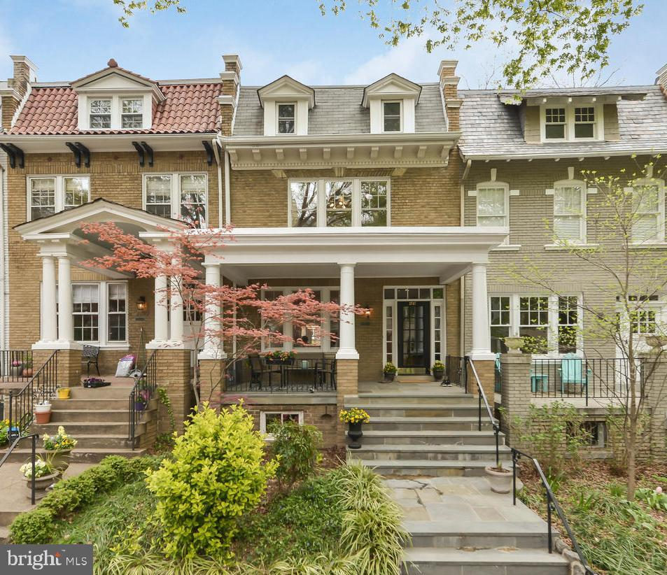 See new video tour  updated Monday 4/6)!  Beautiful and spacious 4/5BD, 3BA house in this chic, walkable, historic neighborhood. Just 1 block to Woodley Park Metro on a quiet tree-lined street. Classic Wardman-style home. High ceilings and exquisite original architectural details combined with many modern updates for today's urban style and energy conscious living.  Full front porch with flagstone, gracious foyer with gorgeous decorative moulding and curved stairway banister, large living room with original decorative fireplace and recessed lighting, spacious dining room flowing to family/breakfast room with wonderful windows across the back of the house for beautiful light. Beautiful original hardwood floors and fresh paint. New quartz countertops in kitchen, glass backsplash, new S/S appliances. Reverse osmosis water filter.  Kitchen flows to  both dining and family room, with additional arched cut-through to the breakfast area giving it an open feel and lots of light from back. Upstairs flexible floor plan includes: master bedroom with updated ensuite bath with skylight, 2 additional generous bedrooms, a den/office, an updated hall bath with skylight, and 2 hall closets for convenience. Bathrooms have fresh white glazing, new gray vanities and pretty new marble tile floors. A large third-floor bonus/attic room is currently used as a teenager bedroom. Very cool! The stylish, renovated l(2018) lower/ground level, includes a 5th bedroom with French door and windows opening to fenced back yard, cute full bath, recreation room, large storage room, and laundry/entrance area that also walks out conveniently to the back yard and parking. Estimated 2500+ sqft of finished space not including storage. Back yard is fenced and low maintenance. Please note the tax record square footage does not show the lower/ground level as finished space. Onsite paved parking for 2 cars. In-boundary for Oyster Bilingual School and convenient to many private schools and nursery schools. Walk 