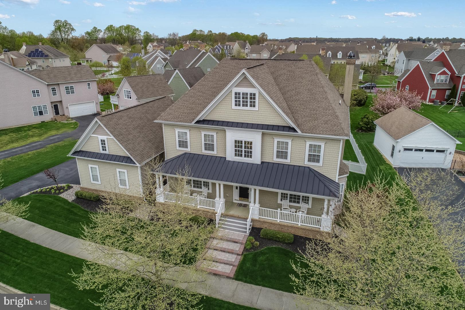 """Visit this home virtually: http://www.vht.com/434056745/IDXS - Welcome to PARKSIDE, one of the most sought after neighborhoods in Middletown. This stunning Anderson ~Fordham"""" model is just under 5000 sq ft.  As you drive to 443 Spring Hollow, you are taken in with a beautiful tree lined street and the curb appeal of this home. The manicured lawn and landscape and the newly finished paver front steps lead you to an oversized beautiful front porch that welcomes you.  Upon entry, as you open the front door, you are greeted with a 2-story foyer and hardwood floors that extend throughout the entire first floor with the exception of one room.  This Center Hall Colonial offers you a grand formal living and dining room with beautiful crown molding and updated colors. As you enter towards the back of this home you are taken in by the spacious family room with a coffered ceiling and a glass tiled fireplace. There is a great office through double glass french doors with tons of natural light. The heart of the home is an oversized entertaining kitchen. The newly renovated kitchen offers 42~ white maple cabinets, a brand-new island that seats six, granite countertops, built-in stainless double ovens, gas cook top and stainless steel appliances (new cook top and microwave 2019). Off the kitchen is a butler~s pantry, a spacious mud room and another first floor half bathroom. The second floor possesses four large bedrooms, one of which is a ~princess suite~, and 3 full bathrooms. You walk up 2 steps into the Master retreat. This large bedroom and bathroom are captivating and include California closets, a three-piece bathroom with a large oversized luxury tub and walk-in shower.  Every upstairs bedroom possesses its own spacious walk-in closet!  The upstairs HVAC was completely replaced in 2019. Lets not forget about the FINISHED BASEMENT!!! As you walk down the recently finished basement you are greeted with the warmth of a rugged barn door that separates you from a custom luxuriou"""