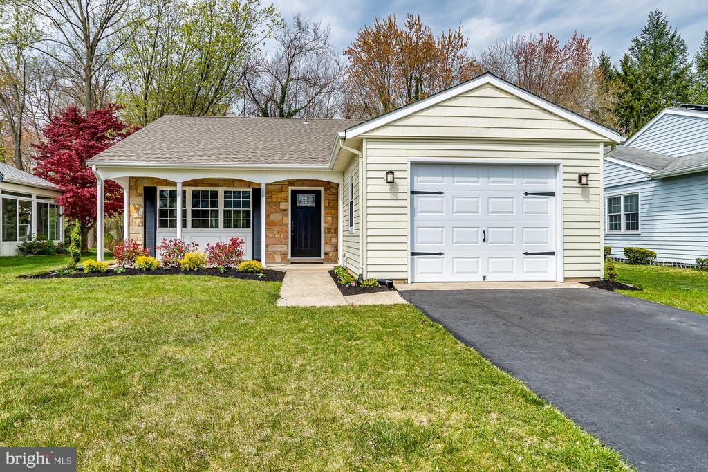PRICE REDUCTION on this totally renovated Expanded Gladwyne with two full baths and new converted three season 210 sq ft addition,  leaving the new owner to move in with nothing to do, but enjoy this beautiful home. The exterior features an architectural roof (2016), replacement windows (2015), siding newly painted, beautiful new custom front door and sprinkler system. The interior features an open floor plan with all new baseboard, interior doors and crown molding, all new lighting including recessed lighting throughout, new 1/2 inch laminate flooring throughout house as well. As you come into front door, there is a foyer closet, and expansive views of living/dining/kitchen combination. The clear Edison light fixtures in dining and kitchen showcase the rooms.  The kitchen has custom real wood cabinets, quartz counter tops and LG stainless steel appliance package.  The slider from dining room opens to expansive  four season solarium with beaded wood ceiling, fan/light, all new windows, porcelain tile floor and new exterior french door. This additional newly completed four season room/solarium gives open, beautiful views of your private backyard and stream.  There is a large storage room in solarium with new shelving as well as a pass trough from kitchen.  The laundry area has new full size washer/dryer unit and cabinet and shelving. the master bedroom has been reconfigured to give a  new full  closet with shelving and a custom  beautiful full bath with porcelain and marble tile, new vanity with storage. The guest bedroom/office has views of backyard and new shelving in closet as well.  The all new custom main bath has a low tub/shower combination for easy getting in and out and stand alone vanity with storage.  There is a new high efficiency heat pump, new 17 seer condenser AC, newer Bradford White water heater, and new 150 amp electrical service with a whole house surge protector added.  The garage has been finished and heated and also has new metal pull down stair