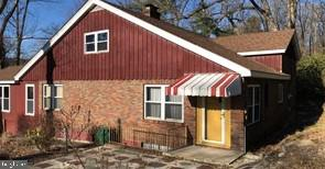 Spacious brick split being sold AS-IS Where IS With All Faults.  Beautiful custom Kitchen with tile backsplash.  Formal Dining Room w-built-in china closet. Wood flooring, mouldings.  Stone FP with slate hearth in Family Room.  Generous BR's, and Full Bath on 2nd Fl.  Sizeable deck and flagstone patio.  Lower Level has 3rd BR/living area, tile floors, utility Kitchen, Laundry area and outside exit.  Nice side and rear yards. Garage is oversized w-commercial features. Not a fixer-upper shell. With some elbow grease, cleaning and few repairs; you can move right in to HUD CASE #446-347293 Managed by Olympus AMS, Property Disclosure and Repair Information and to submit offers: visit HUD Home Store Buyer pays *all* fees including transfer tax and U&O's (if required).~~SF / year built estimated