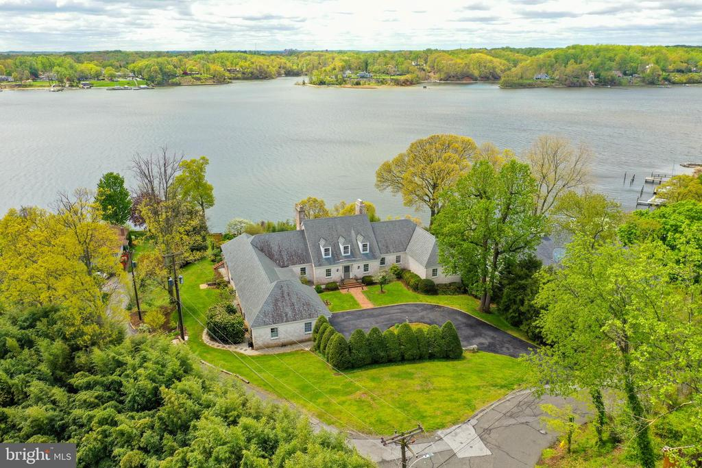 """Located in sought after Winchester-on-the-Severn, this timeless Cape Cod is perfectly situated on one of the most prominent overlooks in Annapolis. With sweeping views of the Severn River and tailored, cascading gardens offering a Spring burst of color, this home is a """"must have"""". Over 4,900 finished square feet with water views from almost every room of the home. Winchester-on-the-Severn amenities include a private beach on the Severn River, boat ramp, piers, marina, beach pavilion, and playground.~Nearby Route 50 provides easy access~to Baltimore and Washington, D.C."""