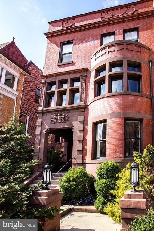 Built in 1890, this stately Victorian-style home, known as The Somerville Mansion, has been meticulously maintained and restored through the years to showcase its alluring turn-of-the-century elegance. Guests enter the main level and are welcomed by the grand reception hall boasting warm hardwood floors, handsome wood paneling, fireplace and 11+ foot ceilings. The adjacent formal living room features elegant, detailed moulding, a tranquil fireplace, and large Southeast-facing bay windows. Nearby, the banquet-sized dining room boasts stunning ceilings with ornate quatrefoil moulding and an adjoining chef's kitchen with stainless steel appliances, expansive granite counters, and floor-to-ceiling windows overlooking the private garden. Up the grand staircase, the entire second level is comprised of the sprawling owner's suite. Features include a peaceful sitting room, en-suite limestone bath with heated floors, a spectacular wood-paneled library, and multiple walk-in closets. The upper level offers three additional bedrooms, two full bathrooms, a home gym and copious amounts of storage. Finally, a separately metered two-bedroom, two-bathroom lower- level rental apartment, an outdoor soaking tub, and an assigned garage parking space complete this one-of-a-kind offering.