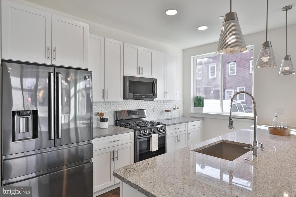 2022 DELIVERY! Welcome to North Liberty Triangle, a modern and luxurious new construction community located in the heart of Northern Liberties. This community offers various amenities including a landscaped courtyard, on-site retail, and a private fitness center. The Unit 4D Courtyard East floor plan, located on the fourth floor of the West Building, is a flat style open concept floor plan located at 1129 Germantown Avenue. This new construction condo features a Studio combination living room/bedroom with one full bathroom, modern finishes, and a carefully designed layout. Walk in to your kitchen area where you will find your designer gourmet eat-in kitchen that features a breakfast bar which comfortably seats between three and four people. You will also find a pantry with shelving and an additional closet for storage. Entertain and lounge in your living area which features a full balcony, adding a touch of luxury and scenic views right from the comfort of your home. This balcony add natural light to a living spaces and the sliding doors are great letting in a breeze during cooler temperatures. This condo includes a laundry and mechanical closet featuring a laundry hook up. Buyers can choose to upgrade their home to include a stainless steel washer and dryer with their purchase. ***HOA/CONDO & TAXESARE ESTIMATES ONLY***   *** This home is under construction! Photographs shown are of recently completed homes by the builder and are not actual photographs of the units listed. Photographs shown are for representation of the floor plan and finishes. ***