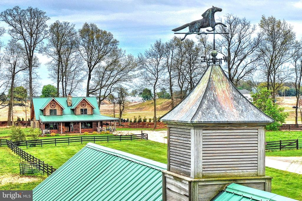 This BEAUTIFUL farm with PRIME level acreage has MANY possibilities!  Are you searching for your that PERFECTLY  located place to start a TRAINING facility ?  How about possibly your own ORGANIC farm?   BUILDERS this is a RECEIVING zone in the desirable I- 83 corridor at the PA and MD line!  CURRENTLY set up for a MONITORED mare and foaling facility as well as horse BOARDING and SHOWS.  QUALITY farm ground for you to start your own TRUCK farm!  Bring your ideas and make it your OWN!  The MAGNIFICENT,  LOG HOME offers VAULTED ceilings, CUSTOM hardwood flooring, CUSTOM built center featured  STONE FIREPLACE , barn style doors, NEW CUSTOM built kitchen with GRANITE counters, custom cabinets with built in CONVENIENCE features, NEWER appliances including STAINLESS steel refrigerator, wall ovens, dishwasher and GAS cook top. The VAULTED living room with custom fireplace flows right off the KITCHEN making this a great area for  ENTERTAINING with a FORMAL dining room just around the corner.  Completing the first floor of this FABULOUS log home is a MAIN  living level bedroom,  FULL bath and  mud/laundry room.  UPSTAIRS from the beautiful wood staircase, across the beautiful pine wood floors to the VAULTED LOFT room you will find magnificent views of the surrounding area. Heading down the expansive walkway and over to the vaulted MASTER bedroom and walk-in closet as well as the attached room currently being used as an OFFICE.  The upper level full BATH offers a JETTED oversize tub and walk in shower.  The custom details just flow throughout.  Completing the homes layout is the full size lower level basement that offers superior walls and plenty of room to add finished living  space and is a WALKOUT!   This is truly one of kind with many EXTRAS to give this home that RANCH like feel from the moment you enter.  The wrap around PORCH invites you to come and stay awhile and relax by your BEAUTIFULLY landscaped pond!   Moving on to the out buildings we have  the HORSE barn with HEATED tack room, 14 stalls including 3 oversize FOALING stalls with VIDEO MONITORING capability throughout, and INDIVIDUAL watering systems installed in 13 stalls to make your watering needs EASY and convenient , also included is the  PERMITTED COWBOY SUITE formerly an office area converted in 2007 that includes kitchen area with stove and refrigerator,full bath, one BEDROOM, living room  and washer and dryer and a HUGE deck.  Also included is the  50 x 120 drive thru POLE  building/ Barn with 12 built in horse  STALLS, tack room, tool room , 2 exterior 14 foot overhangs for all your storage needs and well lighted, sand footing INDOOR riding area!   Look at the magnificent  100 x 200 OUTDOOR LIGHTED ARENA with attached cattle pens and 70 foot round pen with SAND footing!  FENCING the ENTIRE ranch is 4 BOARD STUD fencing!  This OVERSIZE concrete driveway can accommodate multiple vehicles of any size.  The HARD work and DEDICATION to the DETAILS are ever present at this ONE of kind SOUTHERN York County LOG RANCH home.  Waiting and READY for YOU to call this one yours!     * Please contact SHREWSBURY TOWNSHIP with any additional building questions concerning this property*