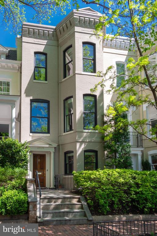 Beautifully renovated in 2019, this townhouse in the heart of the East Village of Georgetown offers 5BR/4.5BA. This home has high ceilings, hardwood floors, an open floor plan, and is flooded with light throughout. The main level offers a formal living/dining room and opens to a spacious eat-in kitchen overlooking the well landscaped rear patio. The newly remodeled mudroom is just off the dining room and patio and is a great space for bikes/strollers/etc. The second level has a spectacular family room with built-in shelving and fireplace, as well as the large master suite with a walk-in closet and private terrace. The top level has 3 additional spacious bedrooms, 2 full baths, and views of the Washington Monument! The lower level Nanny Suite has a separate entrance and full bath.  Abundant street parking is found just around the corner on 28th St.