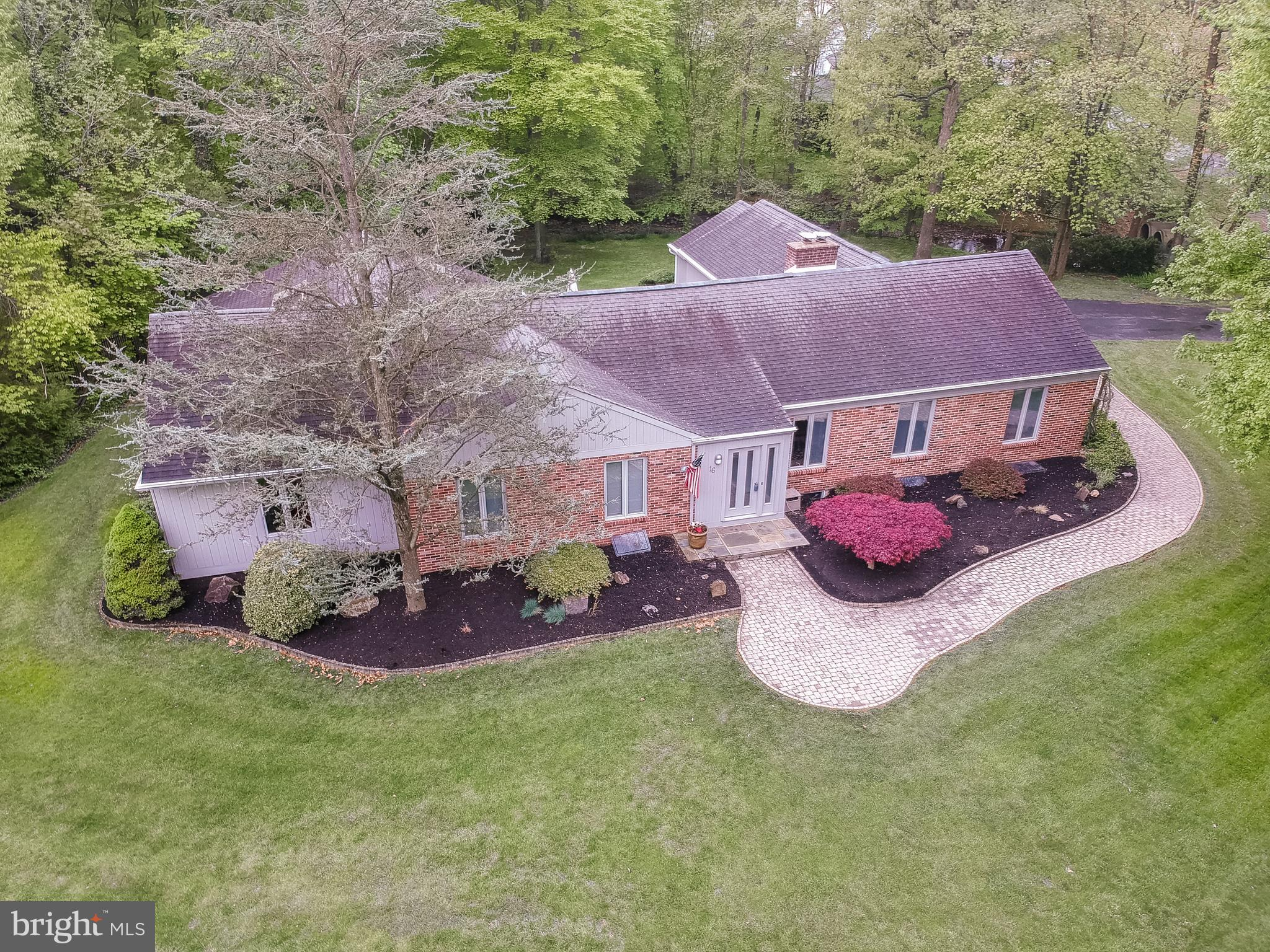 Brandywine Hundred has a secret!  Olde Northminister is a collection  of custom built homes on oversized wooded lots.  The lanes are wide, winding and flow with grace.  The landscaping is sumptuous and plush and the trees are specimens.  16 Broadbent is the flagship property and is perfectly placed on a cleared  corner lot bordered by a brook from a picture book.  No need to leave  your retreat or sanctuary because it has it all.   Float your paper boats outside your door, but remember that premier shopping, top flight schools and award winning  restaurants and bars are within an evening stroll.  The design of this contemporary home boasts spacious, sunny rooms,  flowing floor plan for family and friends and oodles of class.  The master suite has built in storage galore and lots of top shelf extras, not found in other homes.  The family bedrooms features  good closet space, spectacular views and feeling of privacy.  The Great Room is Great and offers you a view to the great outdoors with a brook, terraces and easily landscaped grounds.  Don't forget the fireplaces for those chilly evenings.  The formal living room and dining room are mood-setting and comfortable at the same time.  Your guests will enjoy the ambiance and again the ease of comfort.  Please stop by to see what you have been missing.,  This is truly one of a kind.                                                                                   (all my clients live happily....ever after)