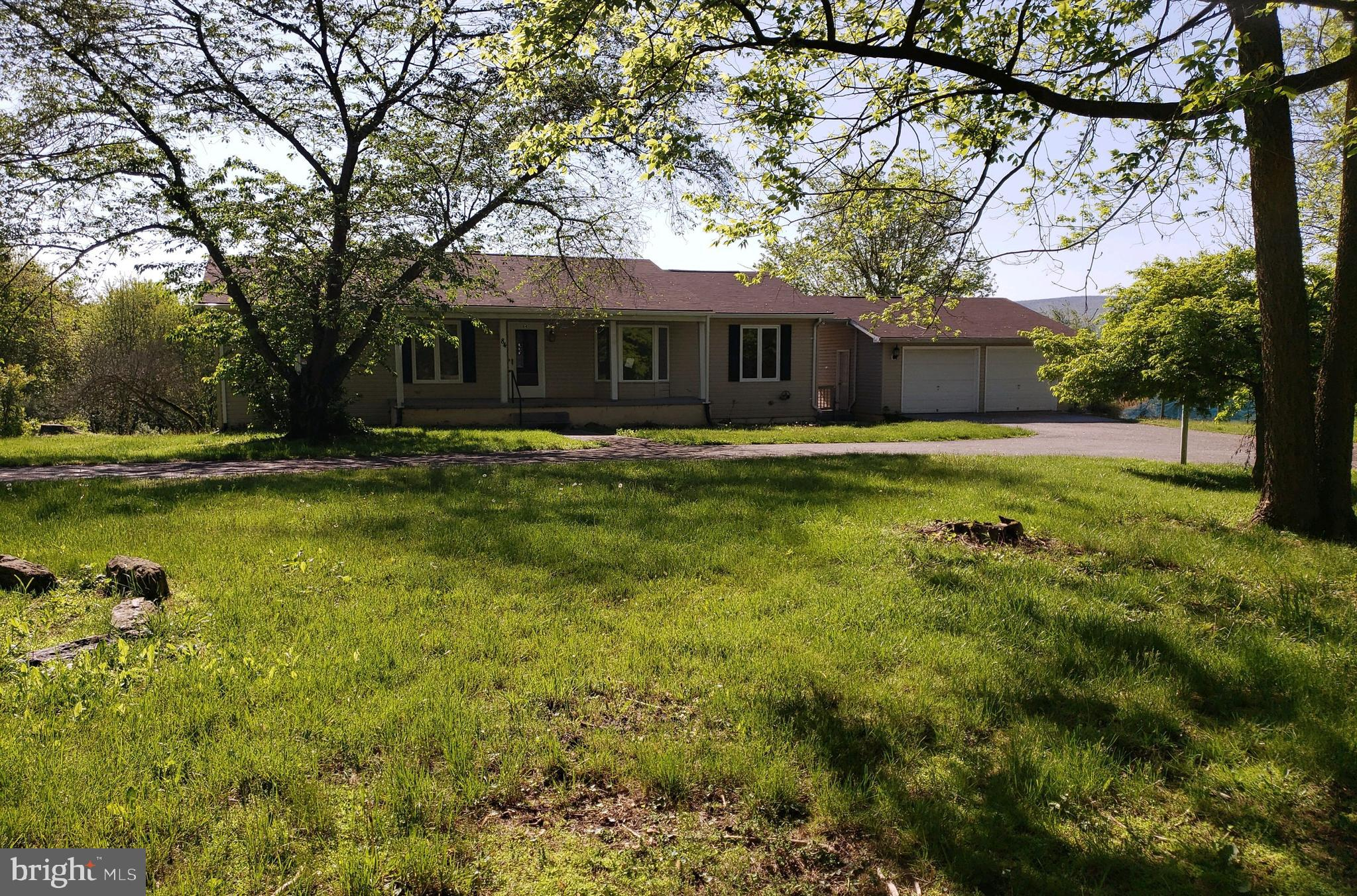 Just off the main road for easy commute, this Ranch style home sits on approx. 1.7+/- Ac lot and features a rear deck, 3BR, 2FB, kit-dining combo, full unfinished basement and large detached garage with built in shelving for extra storage.