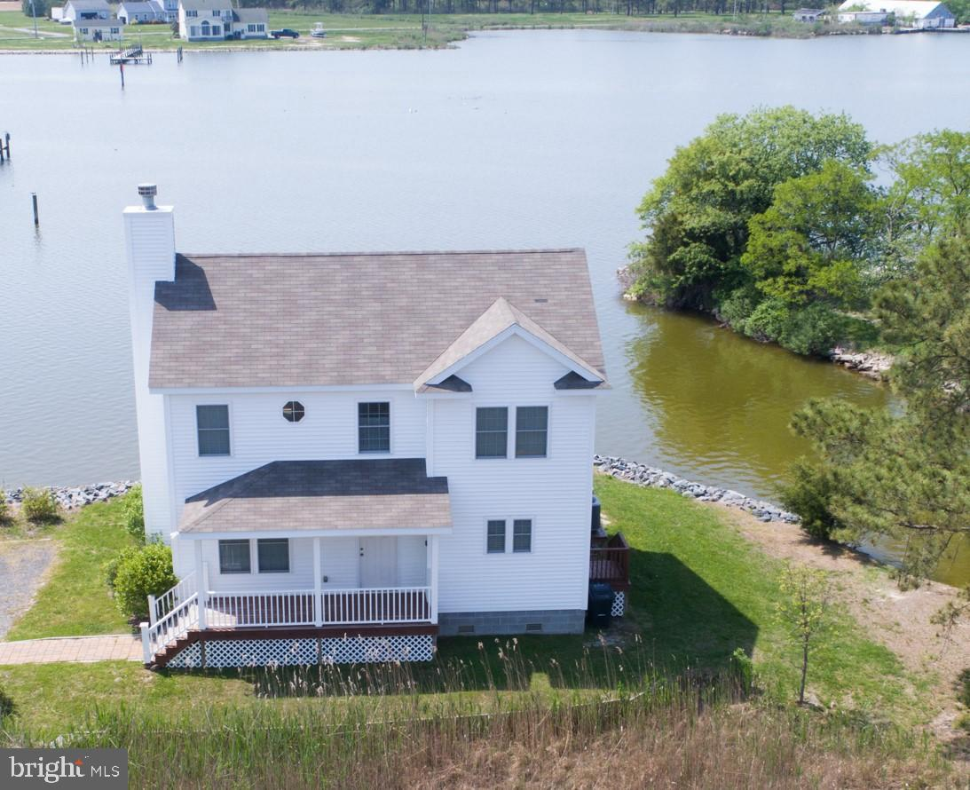This nearly new home offers wide water views over Madison Bay!  3 BR, 2 1/2 bath home full of light and charm. Enjoy the dock, screened porch and decks during the summer, and the wood burning fireplace in the winter.  Rip rapped shoreline, and a cove full of wildlife.    Small yard, but a big view!  Public sewer.  Energy efficient. Fully furnished.