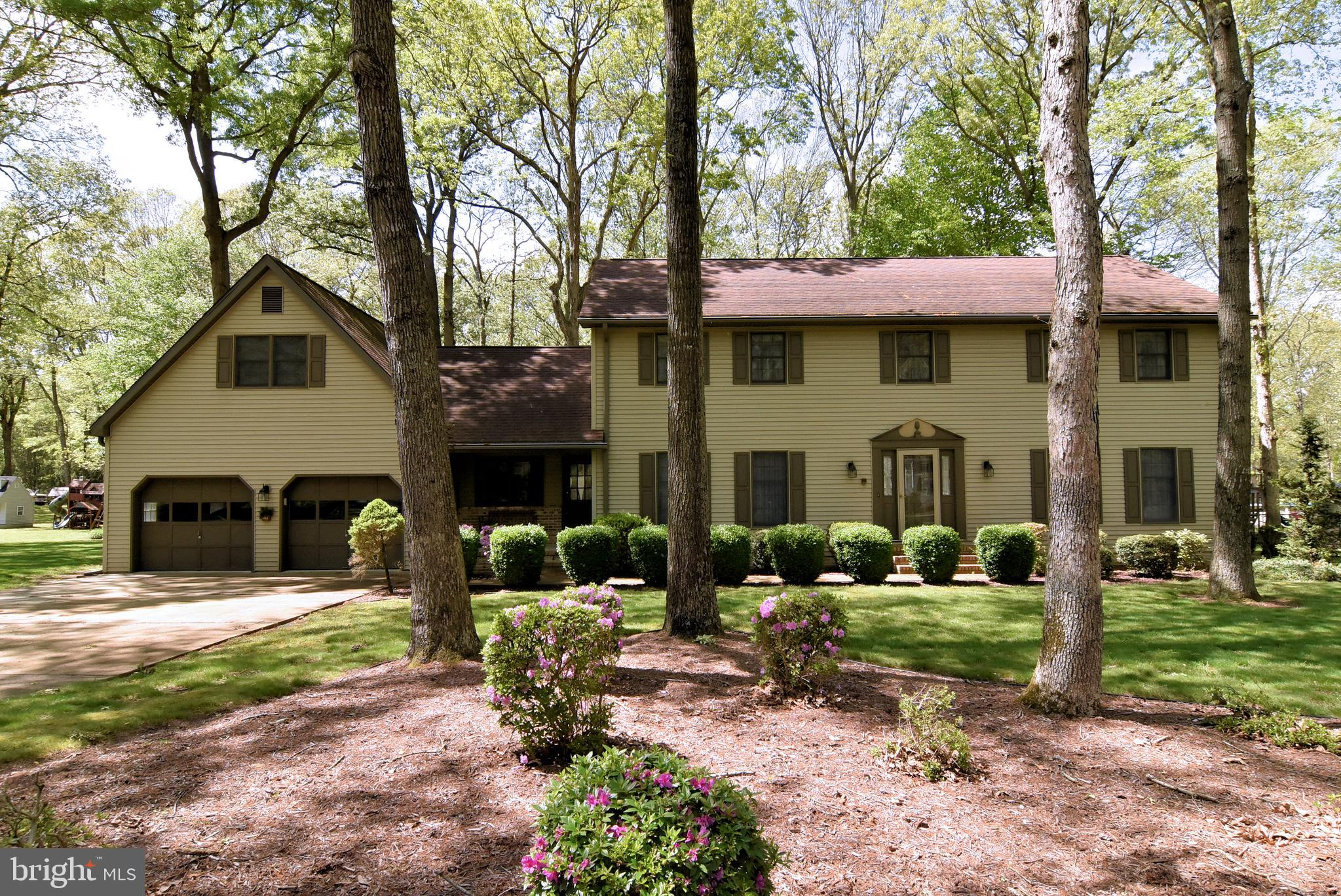 This large home in desirable location just outside Seaford is ready for a new family to enjoy.  Enter from the garage or front into the office/mudroom area with half bath.  From there you enter the large eat in kitchen with bar that is open to the family room with wood burning fireplace.  To the rear there is a 16'x52' deck overlooking the manicured rear yard.  In the front of the house there is a formal living room and formal dining room.  Upstairs there is a large master with walk in closet and dressing table along with 3 additional bedrooms and a hall bath.  At the end of the hall there is an upstairs sitting room and an upstairs laundry with half bath.  Beyond the sitting room is the large game room with cathedral ceilings and another deck.  Oversized (24'x27') 2 car garage and 14'x16' shed for plenty of storage.  Well maintained and  cared for, this home is hard to come by and impossible to replace at this price.