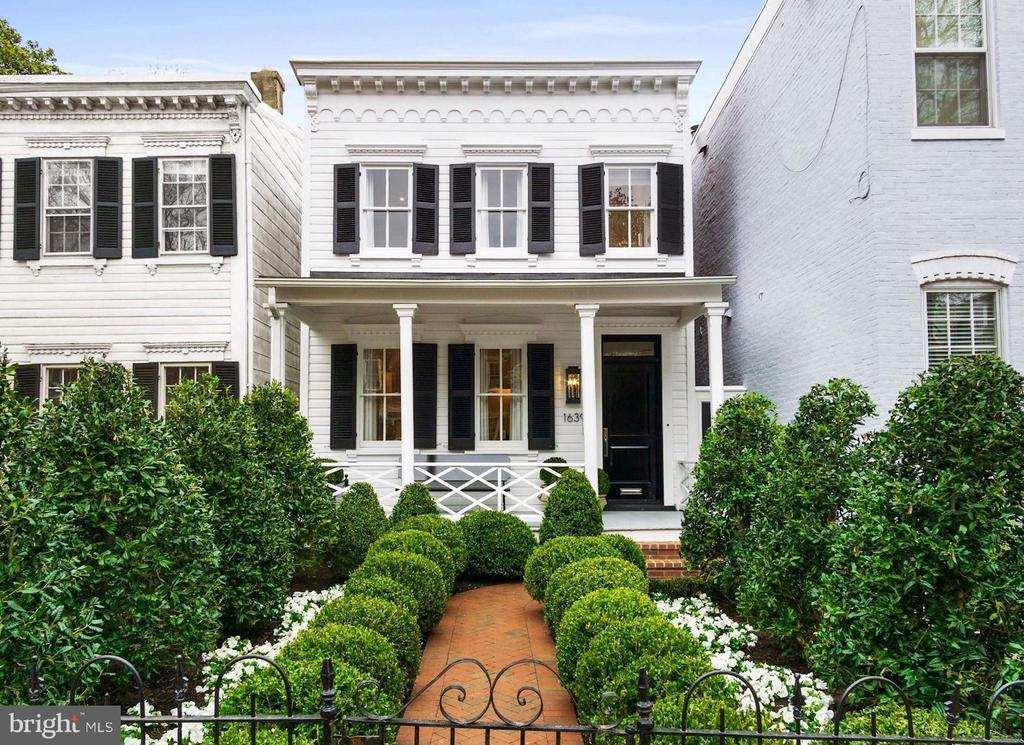 Akseizer Residential does it again with this immaculate Georgetown renovation. A fully-detached colonial home circa 1908 has been reimagined for modern living with no detail spared. The lush gated garden with herringbone brick walkway leads to a charming covered front porch and into an expansive parlor. White oak herringbone wood floors flow throughout the open living space including the Living Room with a marble gas fireplace flanked by custom built-ins, Dining Room, and eat-in Kitchen with waterfall edge island, top-of-the-line Thermador appliances, Waterworks fixtures, and walkout to a professionally-landscaped private rear garden. 4 Bedrooms offer generous storage, and 3.5 Bathrooms feature gorgeous Waterworks fixtures and marble finishes. Added convenience with laundry on both the upper and lower levels. Smart home features include wifi-connected integrated audio, video, lighting, thermostats, security, appliances, and more. All complete with gated parking in a prime Georgetown location.