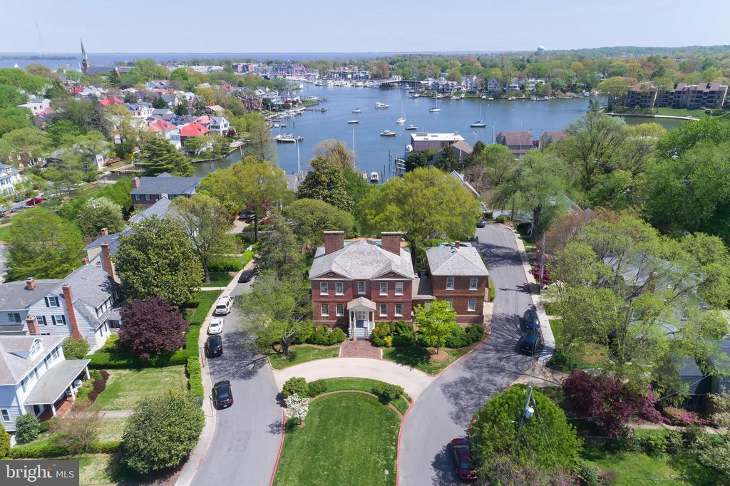 Acton Hall, the only historic Annapolis house on it's original waterfront! Circa 1740 all brick, completely renovated/restored 1981. Fine vintage millwork & pine floors, 8 fireplaces, interior window shutters, jib-doors to veranda overlooking Spa Creek. Large elegant rooms, Foyer w/classic staircase. Formal Living Room & Dining Room, Library, Study & Family Room- all with fireplaces. Gourmet Kitchen, Breakfast Room with attached Greenhouse. Master Bedroom w/water vista, Dressing Room & Marble Bath plus 2 additional large Bedroom each w/marble Bath on the 2nd Floor. Attached Carriage House w/1 Bedroom Apartment w/Living Room, Dining Room & full Kitchen. Beautiful landscaping, gardens, terraced lawns, pool, pool & boat houses & dock. Parking for total 11 cars including Garage, circular driveway & additional parking pad.