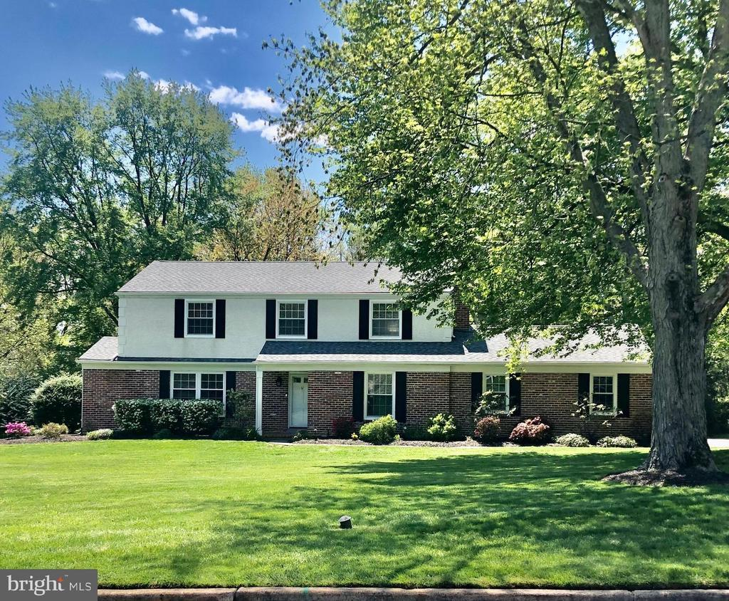 Lovingly maintained 4BR/2.5BA classic brick colonial on beautiful, flat, 1.1-acre lot on one of the most desirable streets in Berwyn/Easttown Township. The home is move-in ready with updates throughout. Rarely is there a property site as flat & usable as this one. Enter the home through the center hall and to your right is a cozy family room with a wood-burning fireplace as well as re-finished hardwood flooring. To the left you will find a large dining room with custom built-ins and beautiful hardwood floors which continue to the sitting room with chair railing, cabinetry and wine fridge with large opening to the kitchen. The large eat-in kitchen has gas-cooking, granite countertops, cherry cabinets and a large center island. From your kitchen window you can appreciate the yard that provides all of the entertainment your family can handle. There is room for it all here! Upstairs the guest bathroom is newly renovated and the entire second floor has re-finished hardwood flooring. The basement is partially finished with a projector/media room and more space to relax! A recently re-paved driveway leads to an expansive three-car garage. WiFi enabled garage doors, doorbell and thermostats (Nest) mean that you can always control temperature and access remotely. A fantastic tree house for the kids, covered seating with lighting and fan on the patio, newer tankless water heater and newer fixtures round out the updates on this property that will feel like home the moment you walk in.