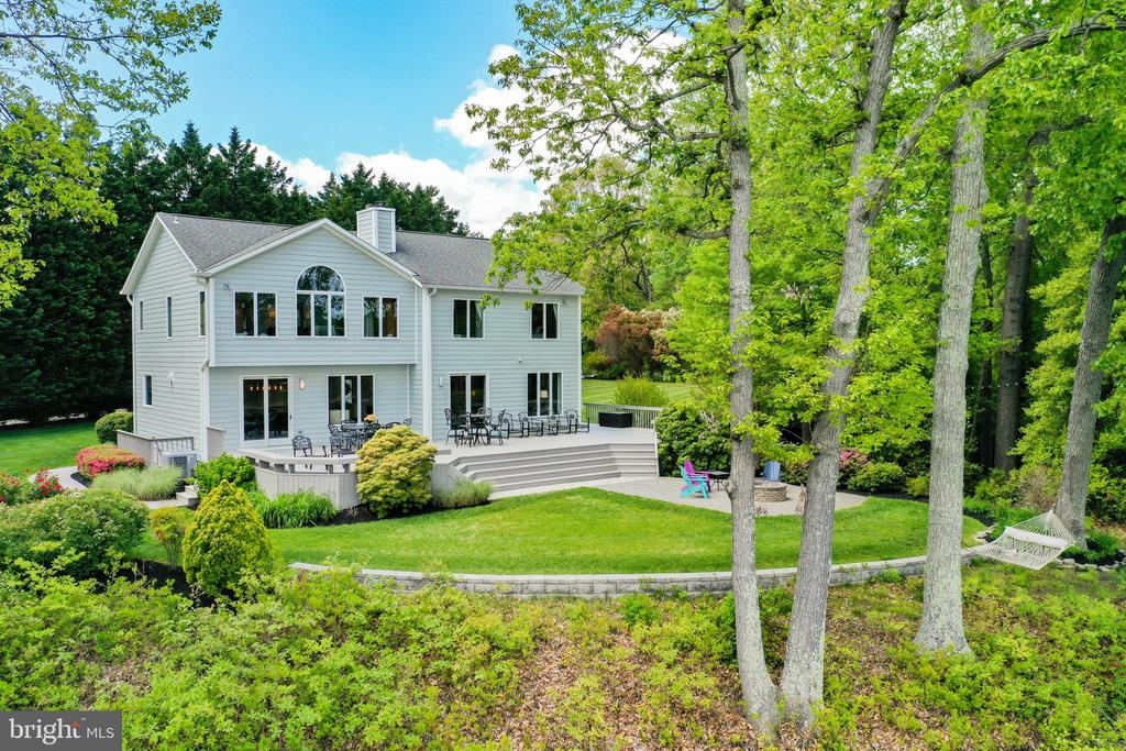 Your private waterfront oasis awaits in Severna Park! Nestled on a 1.08 acre lot, this gorgeous home is waterfront living at it's very best! The moment you walk through the front door, prepare to have your breath taken away as you soak in the water views and open floor design. Throughout the entire house you can enjoy the expansive water views in many of the rooms from sunrise to sunset. The newly renovated main floor includes an exquisite custom kitchen boasting Brookhaven cabinets, a large island topped with Wenge wood and high-end appliances. Relax by the dual-sided gas fireplace with your morning coffee and enjoy the views of wildlife that abound. On the other side of the fireplace there is a spacious family room that is roomy enough for entertaining year round! The main floor includes an updated full bath and bedroom/den/office. The dining space includes matching Brookhaven cabinetry. Upstairs there are 3 sizable bedrooms, a full bath plus the master which has a fireplace, a large bath and 2 walk in closets. In the basement, there is a sizable recreation room and unfinished space for storage. For the waterfront lovers, there are multiple places to enjoy your water views: a large deck accessible from the kitchen and family room as well as a patio off the deck, large grassy areas, you own private sandy beach and pier. These spaces are perfect for entertaining large and small gatherings, nights by the fire, lawn games, fishing, kayaking, boating, SUP, crabbing, swimming and much more! The pier has three boat lifts (10,000, 2,500 and 800 lbs). 200 ft of water frontage and deep water (8+ MLW). Pristine landscape design and full coverage Hunter and Rainbird irrigation system. Brand new HardiePlank siding! Pristine two gar garage with epoxy flooring. Severna Park offers award-winning Blue Ribbon schools, a great sense of community, many fabulous local restaurants, shops and much more! This home is conveniently located for quick access to Rt. 2 for accessibility to Ann