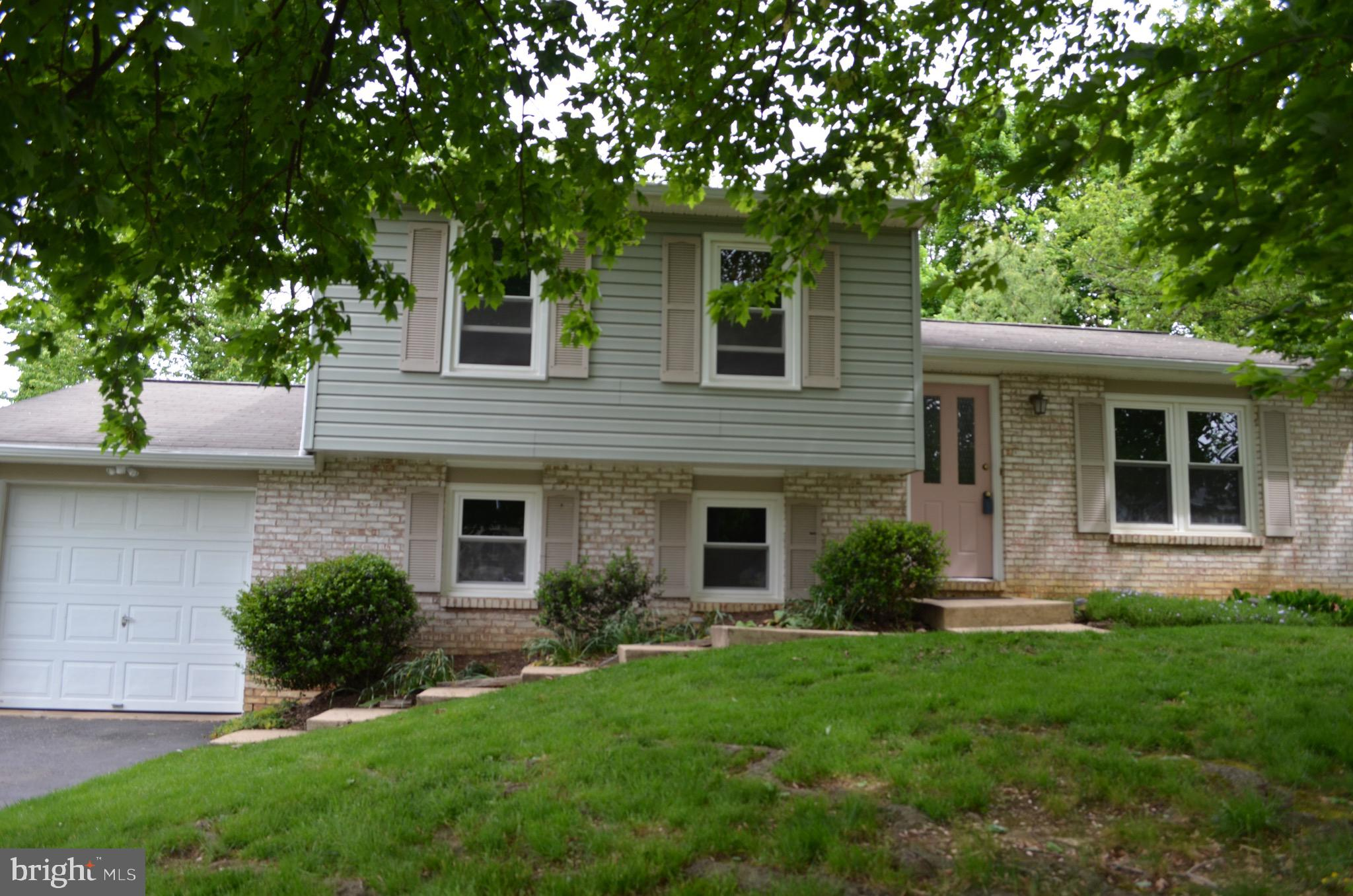 Just in time for summer with its spacious backyard in this freshly painted, split level home in the Four Seasons neighborhood of  Manheim Township. High efficiency windows installed in 2008 along with newer siding and new water heater in 2019 along with updated appliances over the years. Extra seating at the breakfast bar in kitchen with access to the open backyard. Finished lower level boasts a family room, half bath or office/4th bedroom. Oversized, attached 1 car garage with room for extra storage.