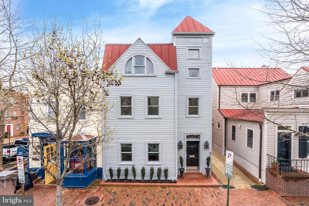 Open Sunday 1-3 by Appointment.  Call 202-641-1200.The elegant yet unassuming exterior of this three story Georgetown row house conceals incredible interior architectural details. Originally built in 1925, the home underwent a significant expansion in 1990 incorporating a spectacular, 30 ft. long, three-story tall atrium with a brand new 16 panel custom skylight. This large, 22 ft. wide home boasts recent improvements including a new roof and gutters, new two-zone HVAC systems, new recessed lights and new USB outlets throughout. Features include generous entertaining spaces, large windows and newly refinished oak hardwood floors throughout. The impressive main level includes a beautifully renovated gourmet kitchen with high-end stainless steel appliances, an adjacent formal dining room, powder room and tall arched doorways that lead to the formal sunken living room. The living room includes 10 ft. ceilings, a wood-burning fireplace, two sets of French doors and a glass wall facing the beautiful rear terrace and garden. Additionally, there is a discreetly concealed 10 ft. automated movie screen with built-in projector components. The second level of the home features a sumptuous master suite overlooking the garden, completed with four closets and an en-suite bath. There is an oversized second bedroom that spans the full width of the house and features a separate sitting area.  This bedroom also features an en-suite bath. Separating the two bedrooms is a hall and library both overlooking the atrium below through a wall of glass. The third level of the residence features two more large bedrooms each with their own separate sitting area and two renovated bathrooms. There is an office, library or playroom with abundant sunlight through skylights overlooking the atrium below. This space, complete with two closets and built-in drawers could easily be converted to another bedroom, bringing total potential bedroom count to six. Lastly, is a fully renovated cellar for extra s