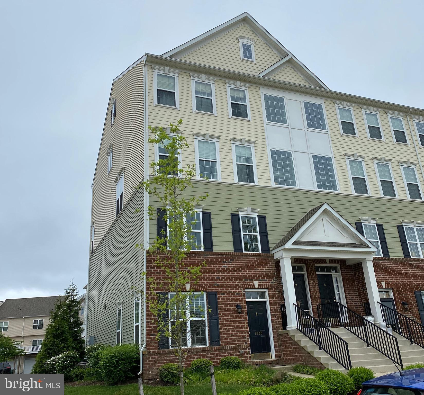 The best of the best of the best is the only way to describe this one-owner end unit Montchanin Chesterfield model.  No options spared with some custom upgrades not even offered by the builder. Welcome to. 3882 Green Street. The largest home on the promenade of Darley Green overlooking the central green space, and the architecturally designed Claymont Public Library. This spectacular unit offers an attached one car garage and ground level basement. Laminate  wood floors, and custom wainscoting give the great room and dining room a resort custom feel and recessed lighting bathe the entire level in warm light. The kitchen is wrapped in 42~ cabinets with crown molding, stainless hardware and appliances and underaged grains countertops. The second living room is also adjacent to a convenient covered deck with storage closet. The main floor powder room is discretely separated from the rest of the living space but is in a convenient location. The master suite is located at the top of the stairs just above the mid-way landing and large picture window. Overlooking the main green space, it features a tray ceiling, recessed lights, a ceiling fan and convenient outlet for indirect ceiling lighting. Step into the master bathroom featuring large format tile, a water closet, massive soaking tub, separate water closet and extended tile base frameless shower that was custom designed by this seller from the builder. Two additional bedrooms and a full bathroom complete the bedroom level. All in all,  this chesterfield was built to break the mold and offers custom touches that are rarely found at this price point. Consider this to be your next home.
