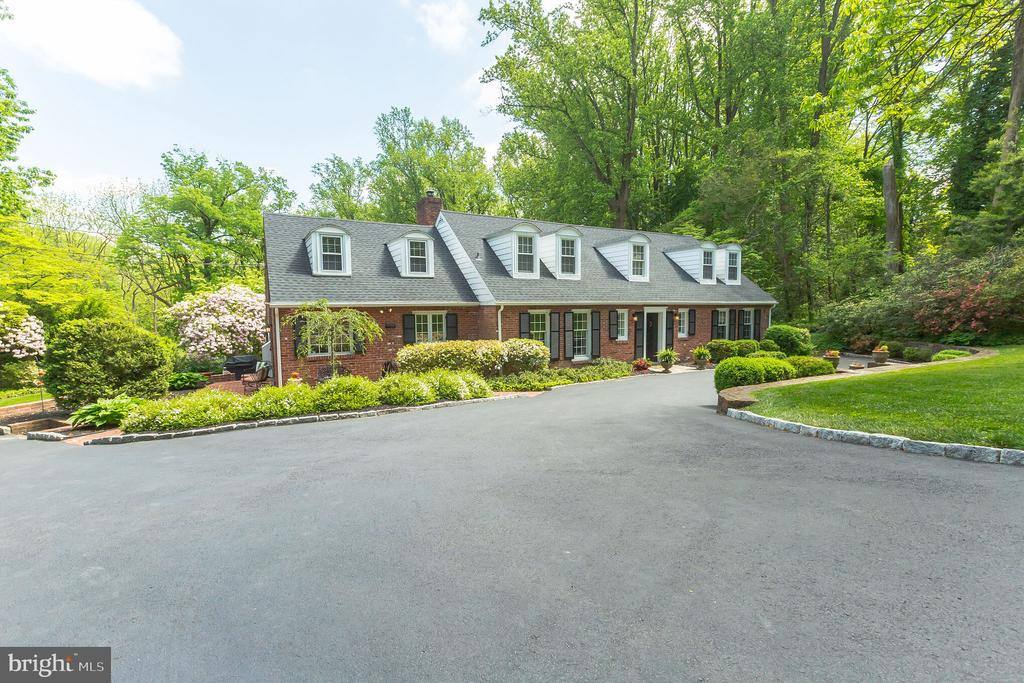 Seller accepting offers site unseen! 360 VIRTUAL TOUR LINK: https://virtual.homejab.com/HOJ/203SRadnorChesterRdVillanovaPA/index.html. You will not want to miss this stunning and sprawling five-bed, five-bath home in Villanova! Enter inside to find a bright and airy foyer with a convenient powder room with a standing shower and storage space. The dining room and living room are both oversized and spacious with gleaming hardwood floors and an abundance of natural light! The fireplace makes the living space feel cozy and intimate while the sunroom off of the living area is perfect for adding more sunlight to the home and for enjoying a summer night breeze. The first floor is complete with bedroom suites, ideal for guest rooms and in-law suites. The upper level has two additional bedrooms and bathrooms plus a massive master suite with a modern bathroom and plenty of space for relaxation. The bedrooms and bathrooms have all been updated with new tile work, fresh finishes, and contemporary fixtures, including marble countertops and custom cabinetry. The rec room offers plenty of additional living space with its stunning hardwood floors and custom closets. With a new pool and patio, 6-car parking, lush landscaping, new HVAC, roof, basketball court, laundry room, and windows plus two master suites, this home is located in the Radnor School District, restaurants, shopping, and transportation making it a must-see, today!