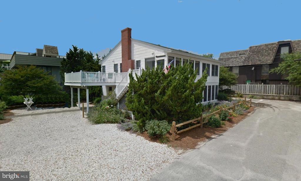Charming Oceanblock beach cottage with an open floorplan. The perfect beach getaway situated just North of town in the highly sought after community of Sussex Shores, known for it's private life-guarded beach and premium location just a short easy walk into Bethany.