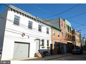 Multiple Opportunities for this property.  Double wide (almost 32') property in Passyunk Square with garage and huge yard.  Currently 2 homes with an opening on the 2nd floor to access full width.  There are 3 great options with this property.  1- There are Approved Plans and Permits for a 5000 sf 3 story home with 2 car garage, 1000 sf yard, roof deck AND a 10 year FULL tax abatement.  Option 2-  Rehab each individual side of the existing homes (1221 and 1223) .  or 3- rehab existing home with garage.  4- aply for subdivison and split the lot to build 2 custom homes.  Owner is a licensed PA real estate salesperson