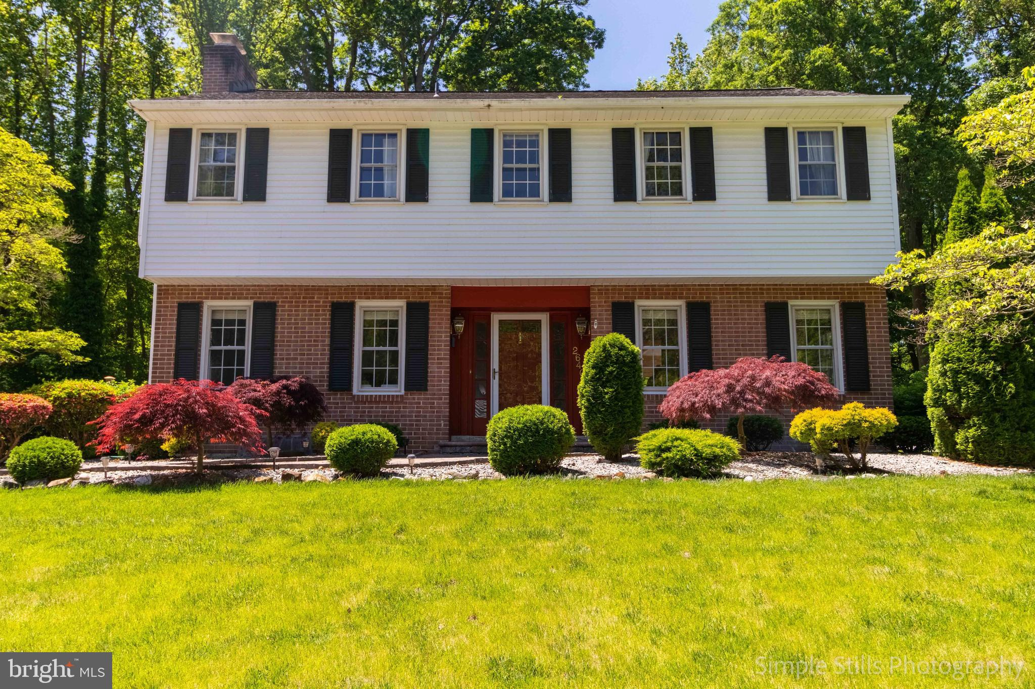 This is the one you've been waiting for in fabulous N. Wilm community of Foulk Woods.  This spacious home is on almost an acre of land and is one one of the larger lots in the community.  Beautiful backyard has mature trees and great open space.  The nice pavers walk way lead you to the front of th house  through the gorgeous landscaped.  The yard is meticulously maintained and the interior is as well, price of ownership shows in every aspect of this home.  Perfect hardwood floors are throughout the house.  The large eat in kitchen offers Corian counter tops, Cherry wood cabinets, gas cooking on a Bosch cook top, dual wall ovens, two sinks, two dishwashers, recessed lighting, skylights, and French doors to lead you out to a large patio and gorgeous backyard with beautiful mature trees.  There are fireplaces in family room and also the living room.  You will love the updated master suite, the bathroom has a nice open design and modern shower, with updated fixtures and an new dual vanity.  It even has a large sitting area / office with dual skylights just on the other side of the bathroom.  The basement is nicely finished and has its own full bath as well as the the 5th bedroom.  New HVAC system installed 2017, the roof in 2007 and the driveway not only extended but widened as well.  This house is super clean, fabulous condition, and has one of the nicest views in the neighborhood~ nothing to do but move in.
