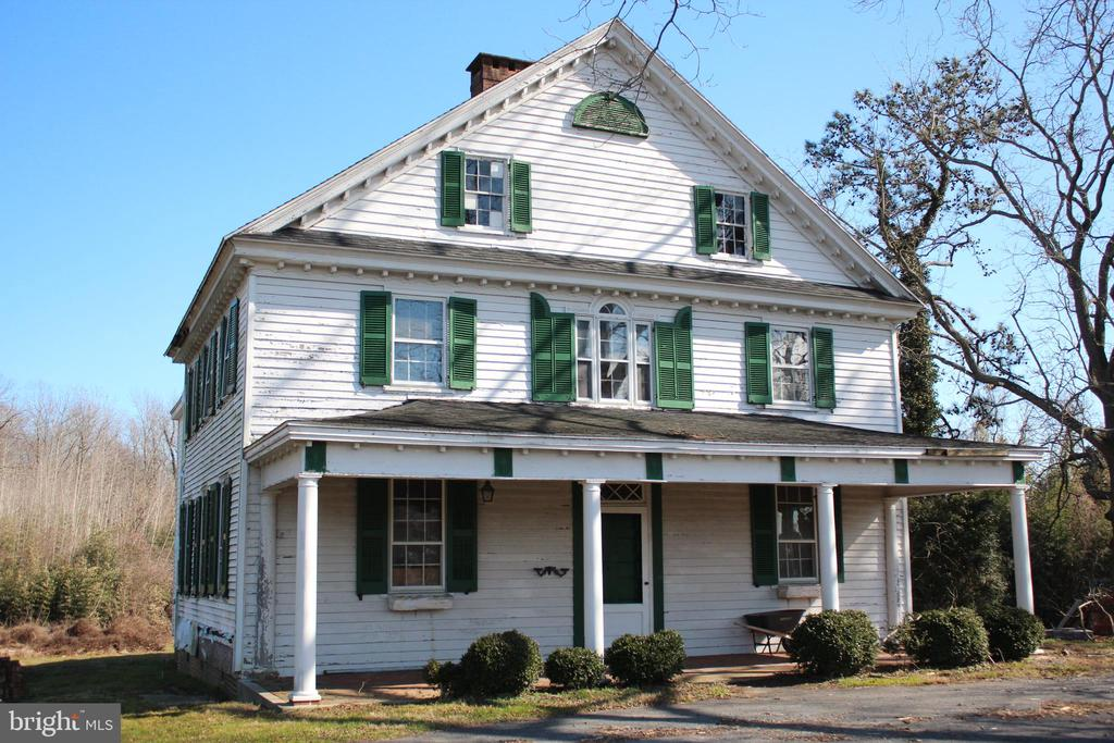 """This Historic home known locally as """"Waverly"""" was built around 1842 and has been totally remodeled from top to bottom. All new electric, plumbing, 3 zone heat pumps, mini-split, 50 year architectural shingles, windows, insulation and on and on. It is located on 3.84 acres +/- across from Worcester Preparatory School in Berlin.  The entry hall leads to a office/library or go straight ahead into the living room with a gas fireplace. There are 5 bedrooms with 2 master suites one of which is downstairs. All 4 bathrooms have tile heated floors and granite counters. Many of the wood floors are original and have been refinished. The all new kitchen with a side eat in area has tile heated floors and  stainless appliances including an upgraded gas range, refrigerator, microwave, garbage disposal, dishwasher and a country sink. Bar seating  with granite counters and tile back splash complete the kitchen. Many of the rooms have double crown moldings and panel  moldings under some windows. The family room has an open wood burning hearth fireplace and beamed ceiling. The second floor master bedroom has a gas fireplace and many closets.  The master bathroom has a claw foot tub and separate tile shower. The 3rd floor recreation room has carpet, a half bath and storage under the eaves. Extra storage in the back section of the 3rd floor and basement.  Outside is a large front porch and another side porch."""