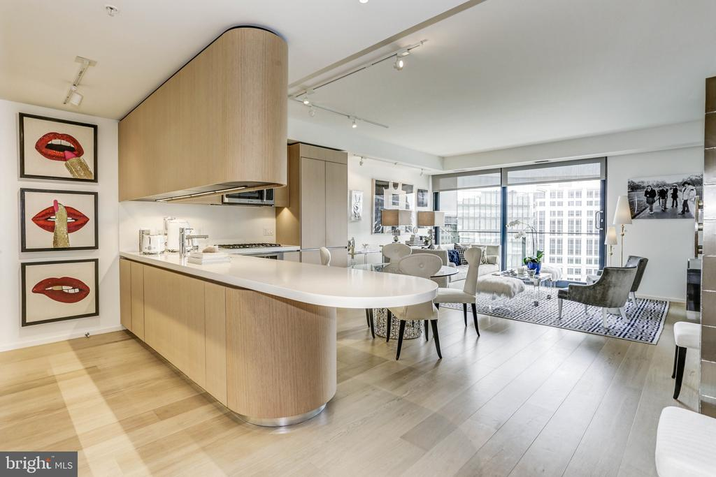 AMAZING NEW PRICE! Don't miss this opportunity. Welcome to this exquisite 1 bedroom condo at the highly sought after Residences at CityCenter. Modern luxury living at its finest. Superbly designed features of this home include an open living space that boasts a dining area, a living room with balcony access, and a gourmet Foster & Partners custom designed state of the art kitchen with a stone island and top-of-the-line appliances. The bedroom features floor to ceiling windows and a modern bathroom with a wall of custom closets, large stone shower, and private water closet. Other special features include a Molteni closet system, wide plank white oak floors, Caesarstone countertops, and dedicated on-premise indoor parking and storage.Owner amenities include a 24-hour front desk concierge, a 2,700 square foot fitness center, yoga room, private massage room, banquet-sized dining room with catering kitchen and bar lounge, private locked wine storage via lottery, executive board room, media room lounge with outdoor landscaped terrace, on-site guest suite, two rooftop terraces featuring outdoor kitchens and an outdoor fire pit. Centrally located , The Residences at CityCenter is within walking distance to three Metro Stops, destination restaurants, world-class shopping, the Capital One Arena, and easily accessible to Washington National and Dulles International airports. .