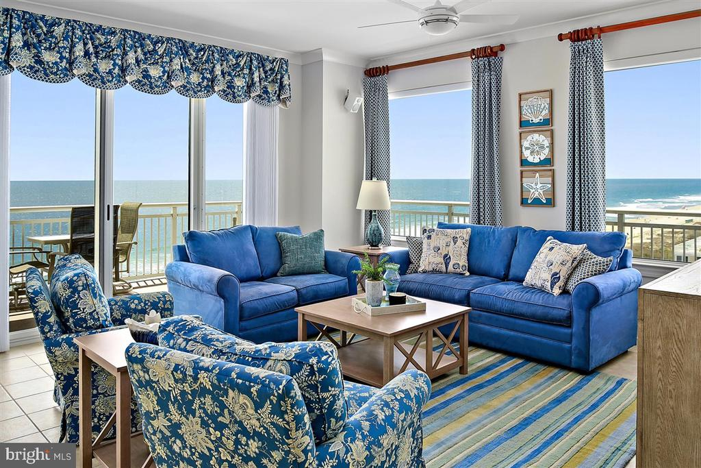 Direct Oceanfront 4 Bedroom 3 Bathroom residence that boasts over 2200 square feet of indoor living space and 426 square feet of outdoor living space divided over 2 separate balconies.  If entertaining at the beach is your goal, you will love this floorplan.  Located on the Southeast corner of the building you and your guests will enjoy panoramic views of the Ocean, City, and Bay.  Delivering designer furnished with nearly all new furniture and decor.  Owner upgrades are extensive including a professionally installed home automation system controlling lighting, 2-zone heating and cooling systems, and all audio/visual equipment.  Hunter Douglas electric shades are installed on every window and slider throughout this home.  Custom window treatments frame the scenic views from nearly every window.  Security cameras are also installed throughout the home to provide piece of mind.  This residence shows like a new model thanks to the current owners recently replacing all of the carpet and having it custom painted.  Do not miss your opportunity to own a stunning luxury beach residence!  Details on additional upgrades are attached to this listing for your convenience.   Deeded ground level storage lockers 69 included with sale.
