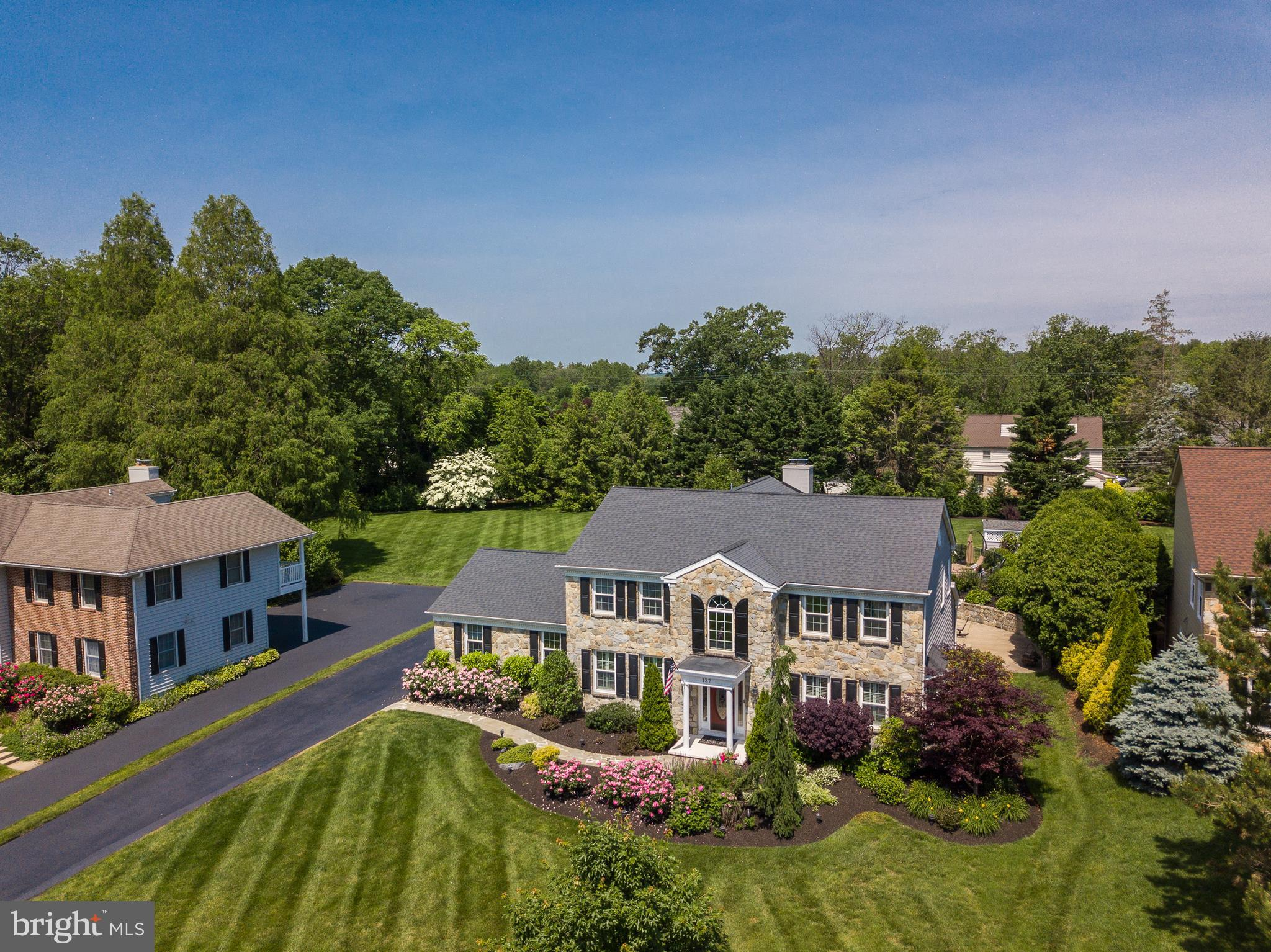 This picture perfect move-in ready, 4 bedroom and 2.5 bathroom Stone colonial located in Alapocas Pointe will not disappoint!  137 Augustine Cut Off has been meticulously cared for by its owners.  As soon as you pull up you will be blown away with the beautiful landscaping.  Enter in through the welcoming foyer and immediately notice a grand chandelier, the beautiful crown molding and pegged hardwood floors that travel throughout much of the home.  To the left are French doors that invite you into a large formal living room, great for entertaining.  To the right is a large dining room perfect for when the family comes to visit.  As you continue into the home you will enter the main family room with a beautiful stone wood burning or gas fireplace you decide, beautiful wet bar with marble countertop and a half bathroom. Attached to the living room is the kitchen which gives you an open flow to the family room.  The large kitchen with center island with seating for five is great for entertaining with family and friends.  Kitchen also features Granite countertops, abundance of custom built-in cherry cabinets painted white and glazed, high-end New stainless steel appliances and a sliding glass door to the outside and over to the 50~ Saline water pool with its own Jacuzzi attached to the poolwith a new diving board, perfect for hot summer days and cool summer nights.  The landscaping around the pool is so inviting you may never want to leave.  The pool has its own pool house, with plenty of storage, to protect all your outdoor equipment. Also, on the first floor is a two car garage with its own heating unit and Bilco doors to access the finished basement to complete the level.  Let~s head upstairs to the bedrooms.  The master bedroom will not disappoint with its own private suite bathroom and a closet large enough to live in, with custom built ins throughout.  Three additional bedrooms upstairs are spacious and include Casablanca remote ceiling fans in each room and a por