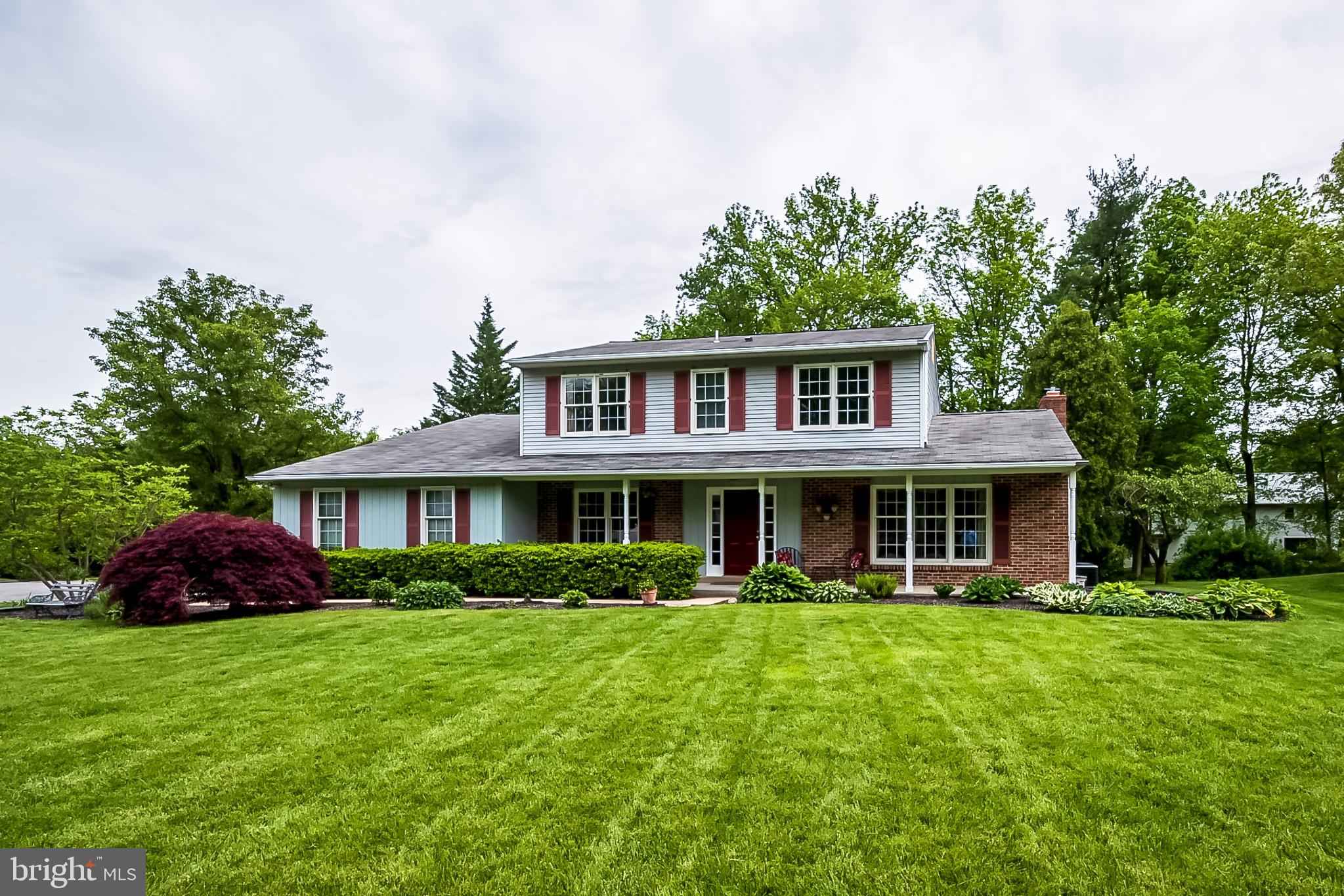 """Visit this home virtually: http://www.vht.com/434070673/IDXS - Welcome to 4508 Pebble Dr, a beautiful 4 bedroom, 2.1 bath Center Hall Colonial tucked away at the end of this quiet cul de sac in conveniently located Rockwood Woods in North Wilmington.This 2750 sq foot stunner has been meticulously maintained and upgraded with only the highest quality materials.Step from the charming front porch into the main foyer with hardwood floors. Glass French Doors open into the formal Living room that can easily double as an in home office or work out room. There is crown moldings and built in cabinets with lighting.Adjacent to the Living Room is the Formal Dining Room that opens into the awesomely updated Kitchen and breakfast area with its own fan/light. Tons of corian countertops, 42"""" oak cabinets that include lazy susans' and glass fronts to display your finest china. Newer GE Profile gas range, Whirlpool Refrigerator,Dishwasher and Disposal and numerous recessed lights. Double French Doors open onto the expansive Paver patio. There is an 18 x 13 Family room with a Brick fireplace and Anderson Sliding doors the open onto a newly resurfaced 18 x 15 deck. There is an actual main floor Laundry Room . There is a 30 x 20  room with a 12 foot ceiling  that was added and used a photography studio which could be easily converted into so many other uses..ie: in-law siute exercise room or home office; The southern wall has been framed to accomidate a 6 foot sliding glass door. It has its own HVAC system and Out side entrance. The master Suite can accomodate any size furniture There is an expansive walk-in closet and a completely remodeled from the walls in a Master bath with tiled walls and flooring and a walk-in shower and a quartz sink. The other 3 bedrooms are very nicely sized. The white hall bath has a tub and shower combination and tiled flooring. The basement has had a French Drain installed with a sump pump.Other quality upgrades include Anderson Windows,  25 years shingle i"""