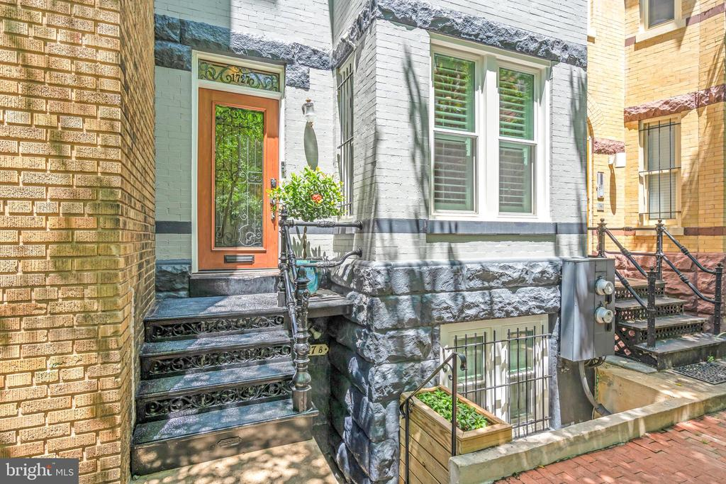 HUGE PRICE REDUCTION!! Please see the property website with 3D tour at: http://sites.changeovermedia.com/1727willardstnw. This classic Victorian row house has been meticulously maintained and beautifully updated!  Includes a fully licensed lower-level 1 bedroom rental unit that currently brings in a net average of $2,850/mo**! Nestled on the much sought after 1700 block of Willard Street, located just steps away from shops, restaurants, and the metro. This gorgeous home features original architectural details and millwork, high ceilings, beautiful crown molding, a classic custom-crafted formal dining room that is perfect for quiet dining or entertaining. Enjoy the upgraded gourmet eat-in kitchen designed by award-winning Lobkovich designer that features custom cabinets, new Caesarstone countertops, high-end appliances and so much more. The second level features an expansive beautifully designed library/family room with custom crafted woodwork and an open floor plan that harkens back to the original design of the homes of that era. The master bedroom features an elegant walk-in closet, a tastefully updated master bath with custom cabinets, and gorgeous marble flooring. The top-level has two spacious light-filled bedrooms and two full bathrooms. This unique home features a temperature-controlled wine cellar, additional storage, and 2 parking spaces in the back. **This house has the unique feature of being a fully licensed rooming house with the potential to rent out all but one bedroom if you so choose. This dynamic home has so much potential, whether you want to utilize its amazing investment opportunity or to enjoy the ambiance and charm of the home for yourself. ** Please reference lower-level pictures of the rental unit.