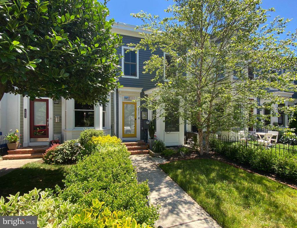 Cleverly disguised behind an unassuming, yet charming facade, this recently renovated 4 Bed/4 Bath home between two of DC's most exciting neighborhoods simply dazzles. Light dances through the leaves and bay window into the dining area, with views to the gourmet kitchen. Two entryways reveal custom grey cabinetry, offering excellent storage, with chef-grade, stainless steel appliances, sleek marble backsplash, and white quartz countertops providing the perfect tools and tableau for picture worthy meals. Light pours down from the upper floors via windows that crown a central, unifying staircase. The first living room, just below the kitchen, includes a  fireplace in brushed metal tile for cozy nights in, while French doors reveal the private back yard oasis, with terraced deck and planting beds. A second living room in the fully finished basement is ideal as a media room or generous home office, with adjoining guest bedroom and full bath. Upstairs, the master suite boasts built-in wardrobe and spa inspired en-suite bath with separate soaking tub and shower, in ethereal glass tile. Two additional bedrooms, each with dedicated full bath, grace the rear of the home, one currently fitted as a luxe dressing room with bespoke, boutique inspired storage. 21st century upgrades, including smart light switches, Sonos, Nest thermostat, Ring doorbell, and smart lock are found throughout the home. Surrounded by the endless excitement of Shaw and U Street, just two blocks from Metro, and three from the soon-to-open Whole Foods! With off-street parking!