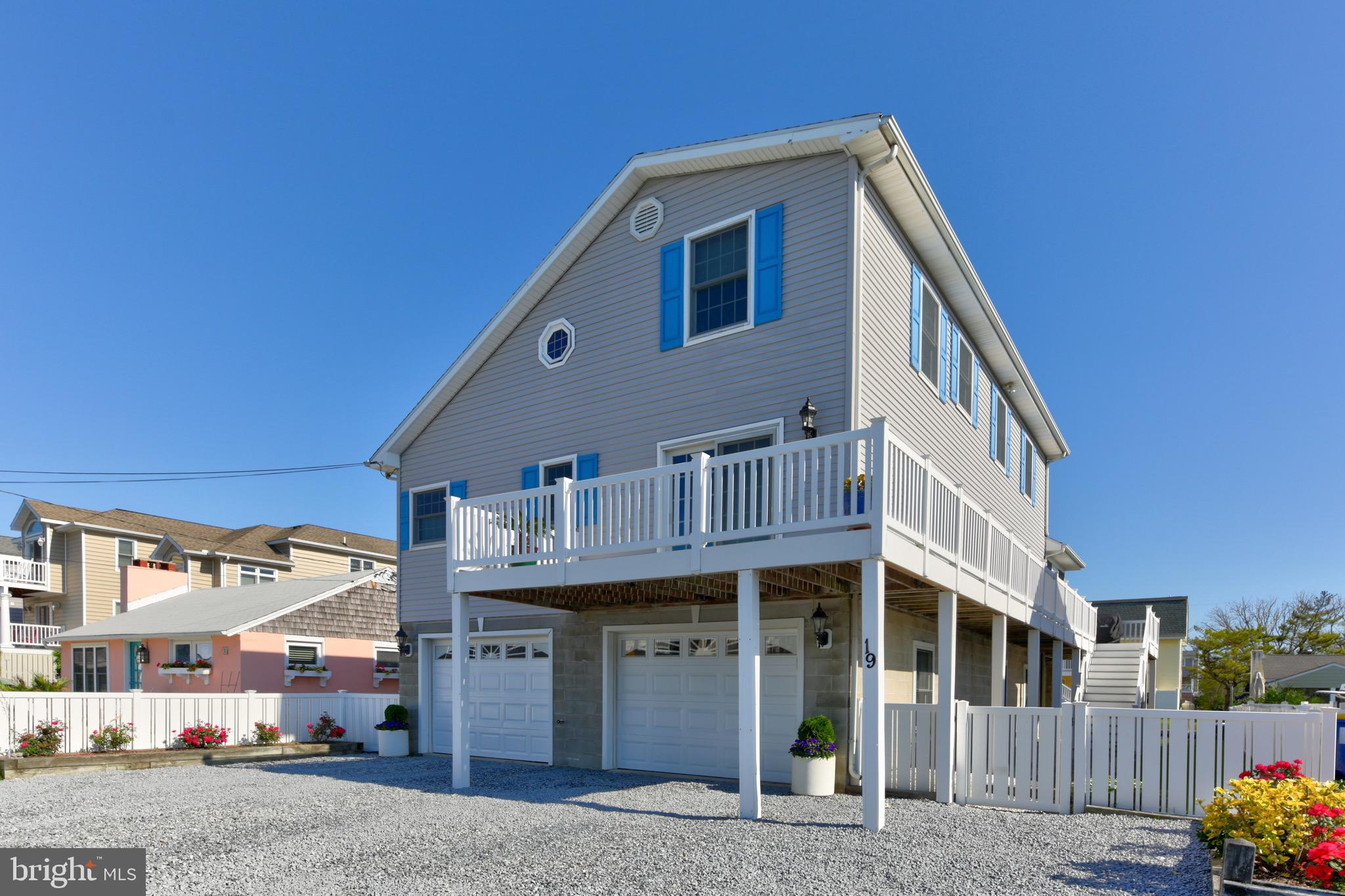Tour this home virtually by pasting link into your browser!   https://my.matterport.com/show/?m=JDNxzQXZ28j&mls=1    Live your best beach lifestyle at this Fenwick Island bayside/canalfront single family home. Raised Salt Box design offers close to 2000 square feet, 4 bedrooms, 2 full baths and 2 half baths.  340+ square feet of wraparound, low-maintenance composite deck with gas grill hooked to propane tank for outdoor grilling enjoyment. The 12x28 three-season sunporch with vinyl tech windows overlooks the canal and provides a great spot for relaxation and bay breezes! 2 car attached garage with additional 500+ square foot storage room and 1/2 bath that leads to the backyard, beach shower w/changing area and the canal. Interior features include gas fireplace with blower, vaulted ceilings in living room, large kitchen island/bar with corian countertops, stainless steel appliances, master bedroom facing south with deck access and peek of bay, laundry room, loft for additional living space, and walk-in attic space. House has dual zone heat pumps (outside units approx. 2-3 years old) backup baseboard heating, Maytag washer/dryer approx. 6-7 years old, and kitchen appliances approximately 4-5 years old. Great location with an easy walk to the beach, restaurants and shopping on a no-outlet street.