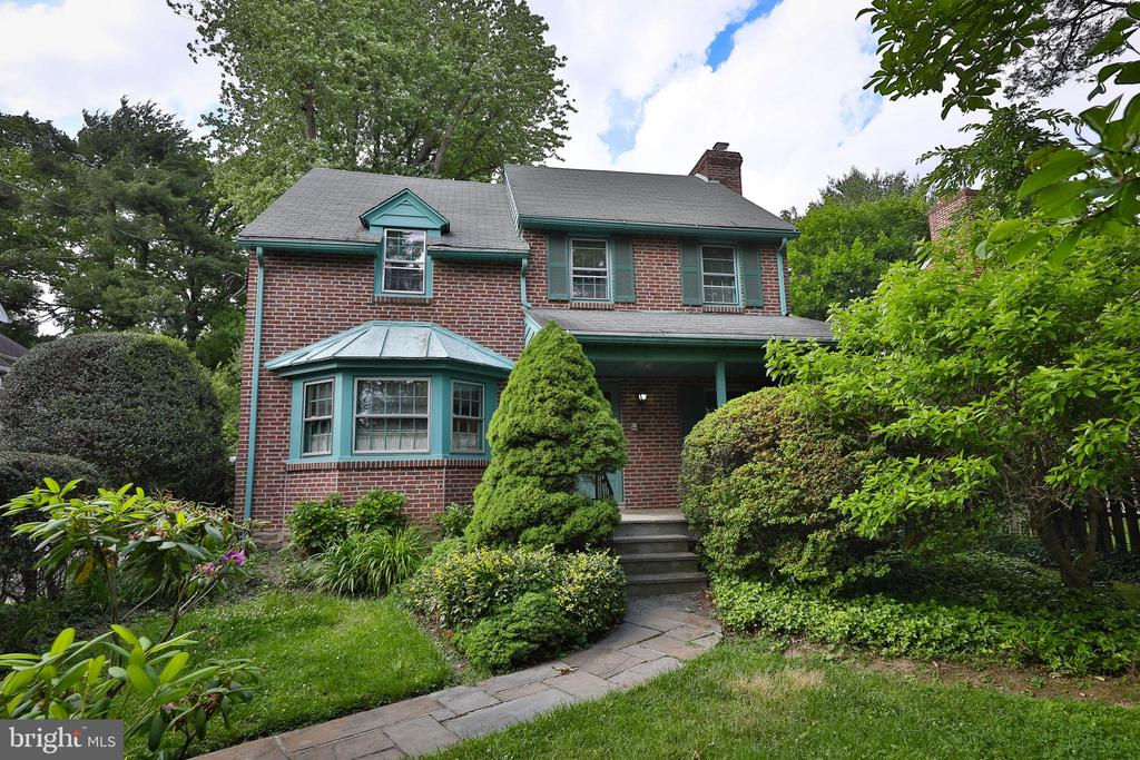 Stunning 4 bedroom 1.5 Bath Brick Construction Colonial home located in highly desirable Lower Merion Township. Blue Stone Slate front covered Porch. Spacious living room offers original Hardwood Flooring under carpets, Crown molding and Wood Burning Fireplace. Large Formal Dining room has original Solid Wood French Doors, Hardwood flooring exposed and Bay window with Triple windows. Bonus Room on main floor enjoys 2 piece half bath and additional space which could serve as a first floor office, Play/Game Room, Sitting Room, Library or whatever you desire. Kitchen has loads of Cabinet Storage and Counter Space, Corian Countertops, Gas cooking and exit to rear fenced in Yard with Slate Patio. Spacious main bedroom has original Hardwood flooring under carpet and His/Hers closet storage. 3 Piece Center hall bath enjoys a vanity with storage, original Tile Flooring and Tub/Shower combo with Tile Surround. 3 additional bedrooms with Ample closet storage. Full basement with storage room and work area, walk-up attic storage, original Solid wood doors throughout with brass handles, updated 200 AMP Electric service and new Central Air. Beautiful home! Tour it soon.