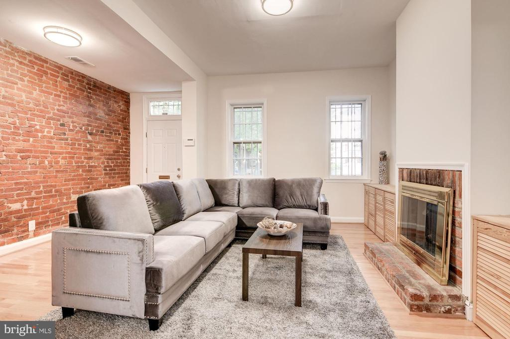 Classic DC rowhome in the heart of the Atlas District with an oversized backyard and rear deck off the upper level.  This  home features 3 Bedrooms, 1 1/2 Bathrooms. The main floor has a traditional floor plan with soaring ceilings and beautiful arched doorways from foyer to living room to the spacious dining room and kitchen ~ extending from the kitchen is a fully fenced deep backyard with potential for off-street parking.