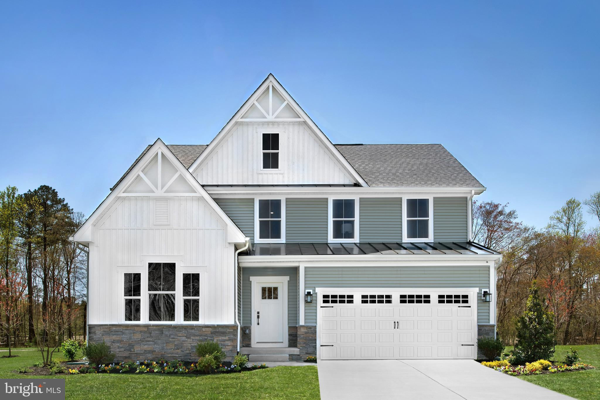 The Stapleton offers the convenience of one-floor living with the space of a two-story home. https://www.nvhomes.com/new-homes/communities/the-estuary. This example features elevation K with a board & batten/siding veneer. The open foyer flows seamlessly into the dining room past the guest bedroom on first floor. A convenient powder room behind the split stair. The living areas of the ~Stapleton~ are open-concept with an open spacious great room. The kitchen sports upgraded cabinets, farmhouse sink and backsplash with a large, functional island and a morning room extension for even more space. Extra windows ensure this is a bright spot for breakfast. The generous Private Owner~s Suite tucked behind the great room is extended outward an extra four feet and includes additional windows and a luxurious tray ceiling. The Owner~s bathroom includes a double bowl vanity and huge walk-in closet and has been customized with a fully-tiled Roman Shower with seat! Upstairs opens to a flexible spacious loft and features two additional bedrooms and another full bath. This home offers $45,290 worth of high end upgrades!