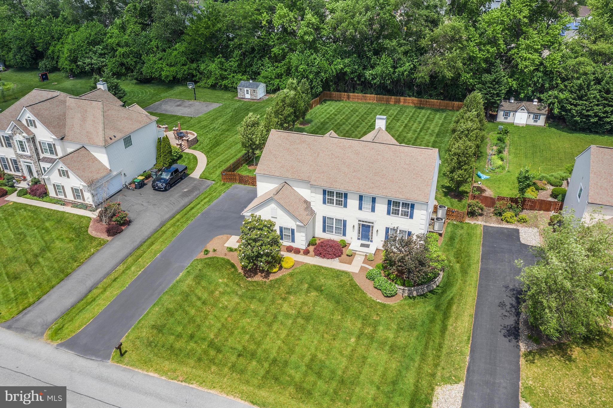 """Visit this home virtually: http://www.vht.com/434074029/IDXS - Tour this home virtually and then feel free to schedule a showing: https://my.matterport.com/show/?m=7SssiyHTFmF&mls=1   Welcome Home to 75 Hempstead Drive in the award winning Appoquinimink School District, offering the perfect lifestyle of convenience and private retreat!  This stucco front home with 2 car side entry garage, architectural shingle roof and great landscaping has eye catching curb appeal.  This model provides an open and contemporary feel while not skimping on rooms.  The grand two story foyer is flanked by the office with french doors and the dining room with crown molding, raised panel wainscoting and chair rail. Stunning kitchen with 42"""" raised panel wood cabinetry with crown molding, tumbled tile backsplash, convenient desk area which makes for a great landing station and area to charge up those electronics, center island with counter seating, built in double sink, expansive amount of corian countertops and sleek appliances, gas cooking.  The kitchen is open to both a bright sunroom with lots of flexibility for a use that fits your lifestyle and a comfortable yet phenominal 2 story family room with dramatic wood work and marble surround gas fireplace and remote controlled blinds.  Tucked away is a dry bar with the recipe for a fun night on your incredible hardscaped patio with stone wall surround overlooking the lush fenced back yard, backing to mature trees.  Living room with crown molding.  Conveniently located powder room.  Main floor laundry room.  Much of the main level has gleaming hardwood floors.  Unique front and back staircase leads you to the upstairs.  Master suite featuring double door entry, tray ceiling, triple windows, huge walk in closet, tiled master bath with expansive vanity with double sinks, soaking tub, large stand up shower.  Rounding out the upstairs are 3 additional bedrooms all of good size with great closet space and a full tiled hall bath with double sinks"""