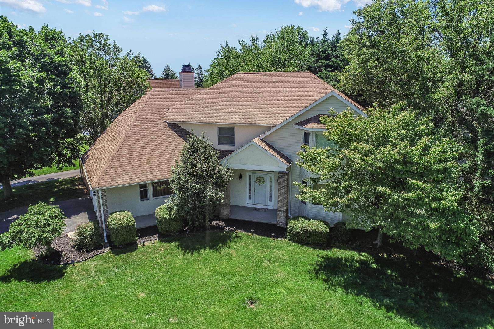 Welcome home to this 4 bedroom, 3/1 bath contemporary stunner! Walk up through the covered front porch and once inside you will be greeted by a 2-story foyer and a grand, turned staircase. You will notice beautiful hardwood flooring that extends throughout most of the main level. Immediately to your left are a coat closet and a discreetly placed powder room. To your right, enjoy the added functionality and space of a formal living room leading into a formal dining room. Or you can enter the home from the attached 2-car garage through the convenient combination mudroom/laundry room. From the foyer, you are led to the expansive open kitchen, which is a home cook's paradise, complete with stainless-steel appliances, granite countertops, a tiled backsplash, ample cabinet space, and a uniquely shaped center island with breakfast bar and pendant lighting. The kitchen also features a breakfast nook complete with a sunny bay window and in the adjoining family room, you can enjoy the warmth from a corner wood-burning fireplace. Sliders from the family room/breakfast nook lead out to the spacious rear deck with built-in seating where you can enjoy a fully fenced in backyard! The front and side yards have also been beautifully landscaped. On the second floor, you will find a large master suite that includes an oversized office area and a full en suite bath with a jetted tub, walk-in shower, double vanity, and an enclosed toilet with a skylight. Three more bedrooms with large closets and a full bath with tub, shower and double vanity complete the upper level. Downstairs provides even more of an abundance of space in the fully finished basement with wall-to-wall carpeting, a tiled fireplace, a full bath with a stall shower, and a large utility room. This home offers endless possibilities and is conveniently close to shopping, schools, I-95, and everything the Brandywine Hundred has to offer, schedule your tour today!